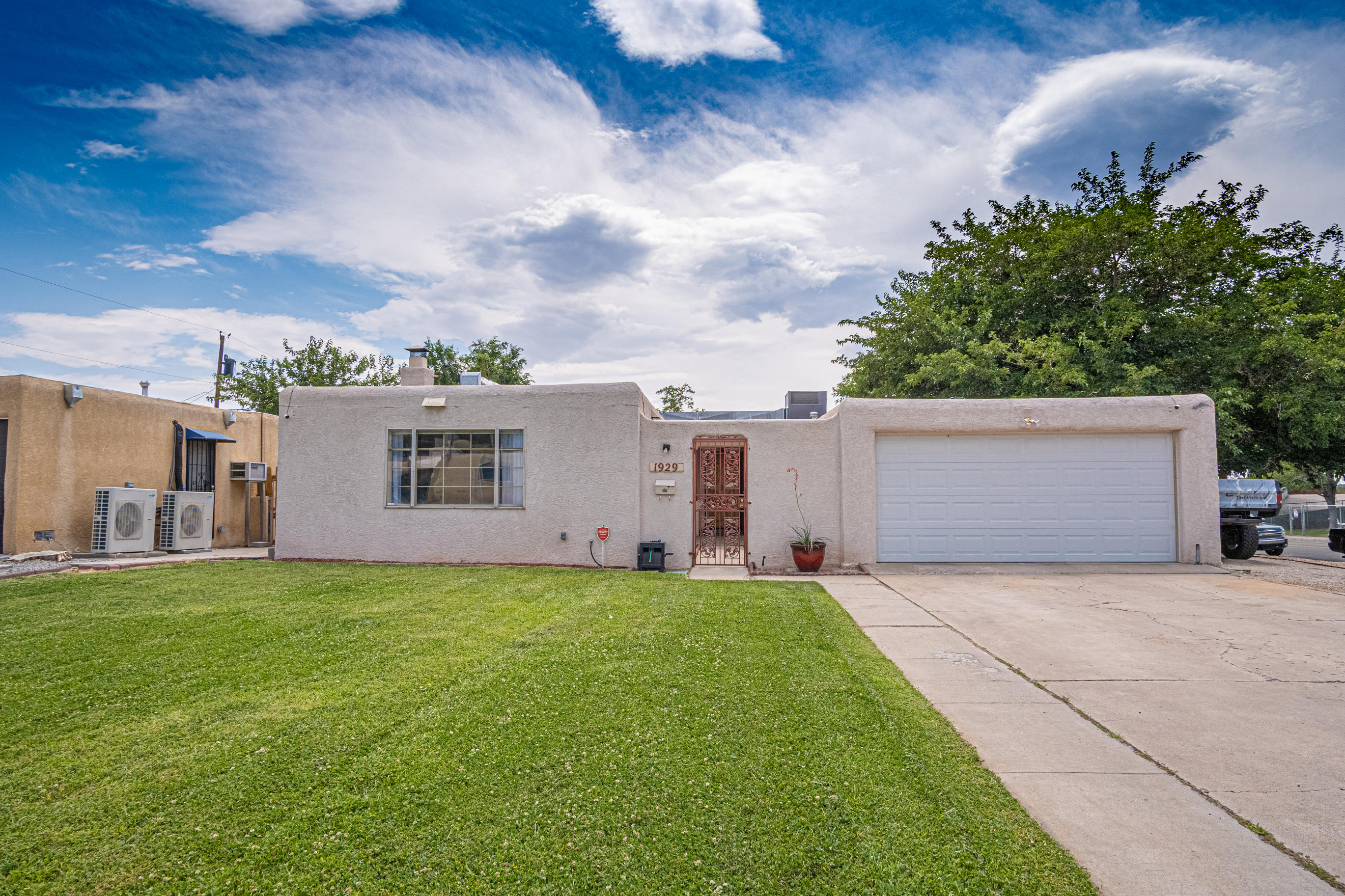 BEAUTIFULLY REMODELED SINGLE STORY HOME IN THE NE HEIGHTS!!!  This 1961SF Home has 2 large living areas, 3 bedrooms, 2 baths and 2 car garage and has many recent updates!  Master bath was remodeled in 2021, New Ref AC 2020 with 10 year warranty, New security camera system with 8 cameras stays, New Kitchen Appliances 2021, FP & Wood burning stove, beautiful laminate flooring and ceramic tile.  NO CARPET!! Kitchen has beautiful Cabinets, Concrete counters, Tile back splash! The front courtyard has a nice security gate! You will love the shady backyard and large covered patio!! Front and back yards are nicely landscaped with lawns and shade trees!  Two large storage sheds in the backyard stay! There is a side area for parking an RV, etc!