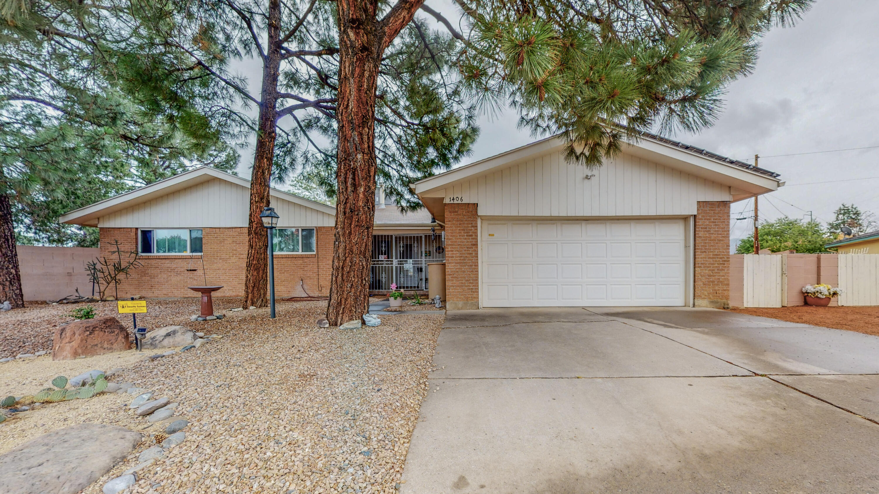 Great NE location in Snowheights neighborhood, close to Uptown, stores, freeway and restaurants. Great floorplan, with 1974 Sq. Ft, 3 Bedrooms, 1 Full Bath, 1/2 Bath and a powder room. Kitchen has been remodeled within the last 5 years and opens to Great Room with a wood burning fireplace. Private backyard features a covered patio and a gated play structure with plenty of room to entertain.  Situated on more than 1/4 acre in a quiet cul-de-sac with HUGE backyard with side access for RV/boat storage with a clean outs to dump your trailer. Backyard storage is on a permanent foundation. 5 rain barrels surround the home to water the beautiful fruit trees and plants. Come take a look at this Beauty, this might be the home for you! Solar panel are owned!