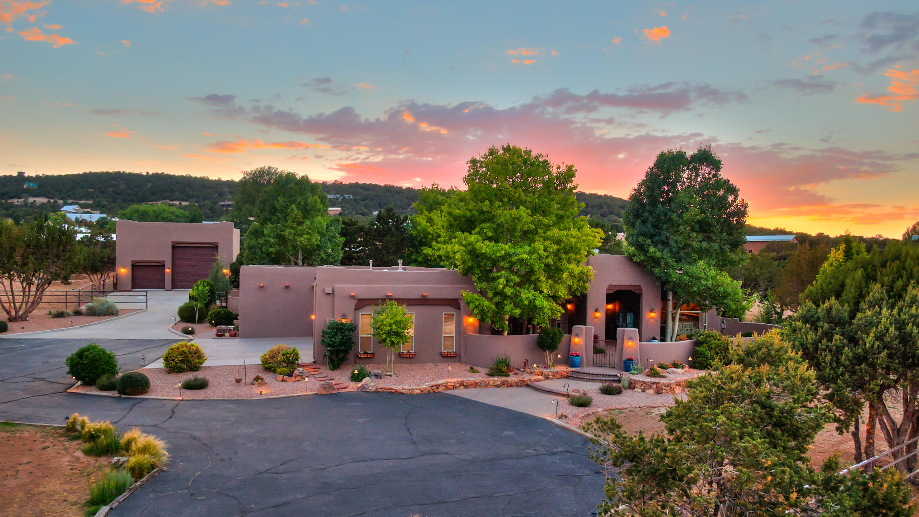 Tucked away in an upscale mountain neighborhood this updated luxury estateenjoys 3586 Sq. Ft. on 4.11 landscaped acres with 4 bedrooms 3 baths, home office and attached 3 car garage with freshly painted floors. Fully fenced with private gated entry, equestrian facilities, RV garage and flex space. Timeless quality with newer roof, stucco, LED lighting and freshly painted making it truly a move-in ready home. An entertaining floorplan complete with formal dining room, family room and open kitchen to easily access the backyard patio. Custom cabinetry, abundant storage, wood floors and tile throughout. SW features include vigas, nichos and 2 custom gas fireplaces.  Double ovens, gas stove and beautiful views while you cook make the kitchen the heart of the home.