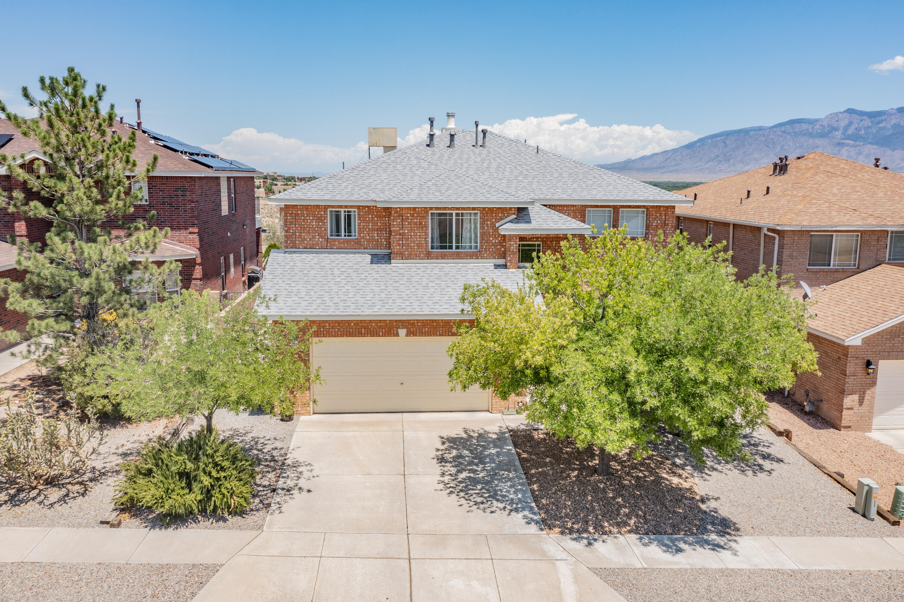 THIS is the Dream Home you've been waiting for! Stunning Remodeled Property w/Sweeping views of the City, Sandias & Valley! Avoid crowds & Enjoy Balloon Fiesta on your own private balcony! Gorgeous Wood Tile Downstairs & Top of the Line Carpet Upstairs. Light & Bright w/Sprawling Ceilings in Living Room w/Gas Fireplace and Open Kitchen w/Quartz Countertops, Massive Island w/Bar Seating & Double Ovens. Formal Dining Room w/Crown Molding, Office/5th Bedroom downstairs & Loft Upstairs. Tandem 2.5 Car Garage w/Large Storage Room that's Heated/Cooled. Impressive Primary Suite w/Oversized Ensuite Bath w/Jetted Tub & Enormous Walk-in Closet. Newer Roof 2019. Central Vac. Semi-Custom Stillbrooke Home. Fully Landscaped on .21 Acre. Convenient to Paseo for a quick commute to the East Side.