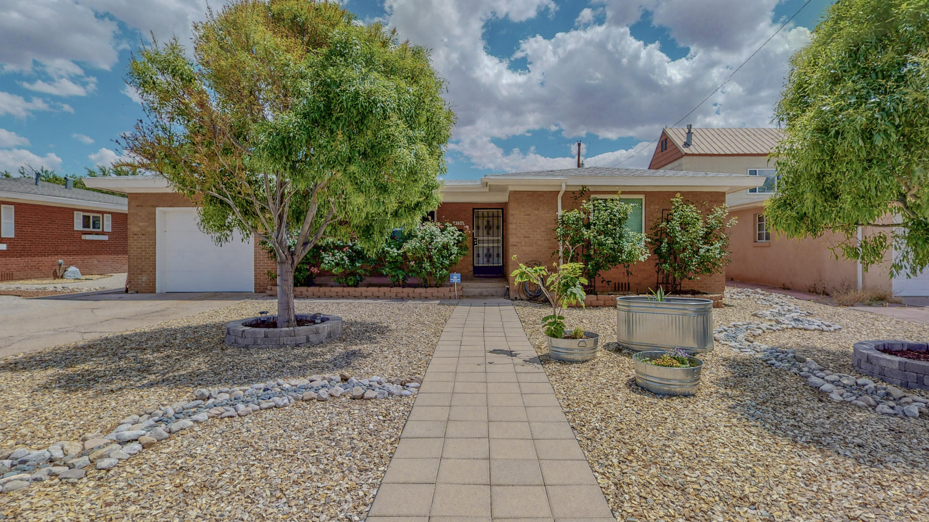 It is like a new home but gorgeous hard wood flooring and coved ceiling details.  Living room with cozy wood burning fire place, built in book shelves.  Renovated 2015 with refrigerated AC, new plumbing and elec., and new windows.  New roof in 2019 with energy star rated shingles.  Kitchen w/stainless steel appliances including gas double oven are from 2015 and new contemporary tile flooring.Buyers will appreciate the easy maintenance front yard and back yard with grass area, fire pit and trees:  two pomegranates, a brown fig and a pineapple quince tree.Location says it all for proximity to Nob Hill, hospitals, UNM, KAFB and Sandia Labs.