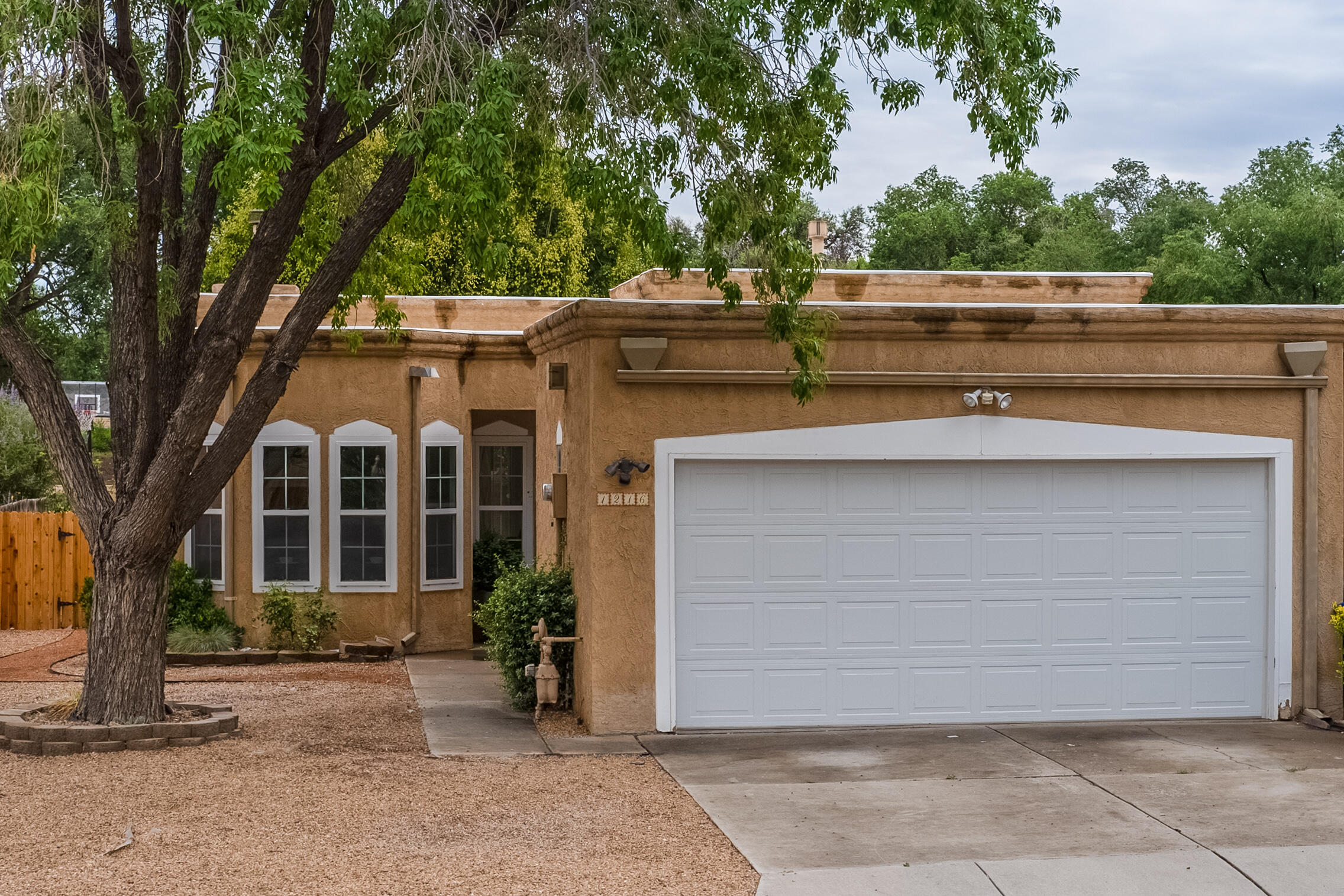 Super nice townhouse in the NW Valley.  2 large bedrooms and 2 full baths with fireplace, high ceilings, built in bookcase, with 2 car garage with built in storage.  This townhouse is ready for you to make an offer. Conveniently located to shopping and a quick drive from Old Town. Come see this today.