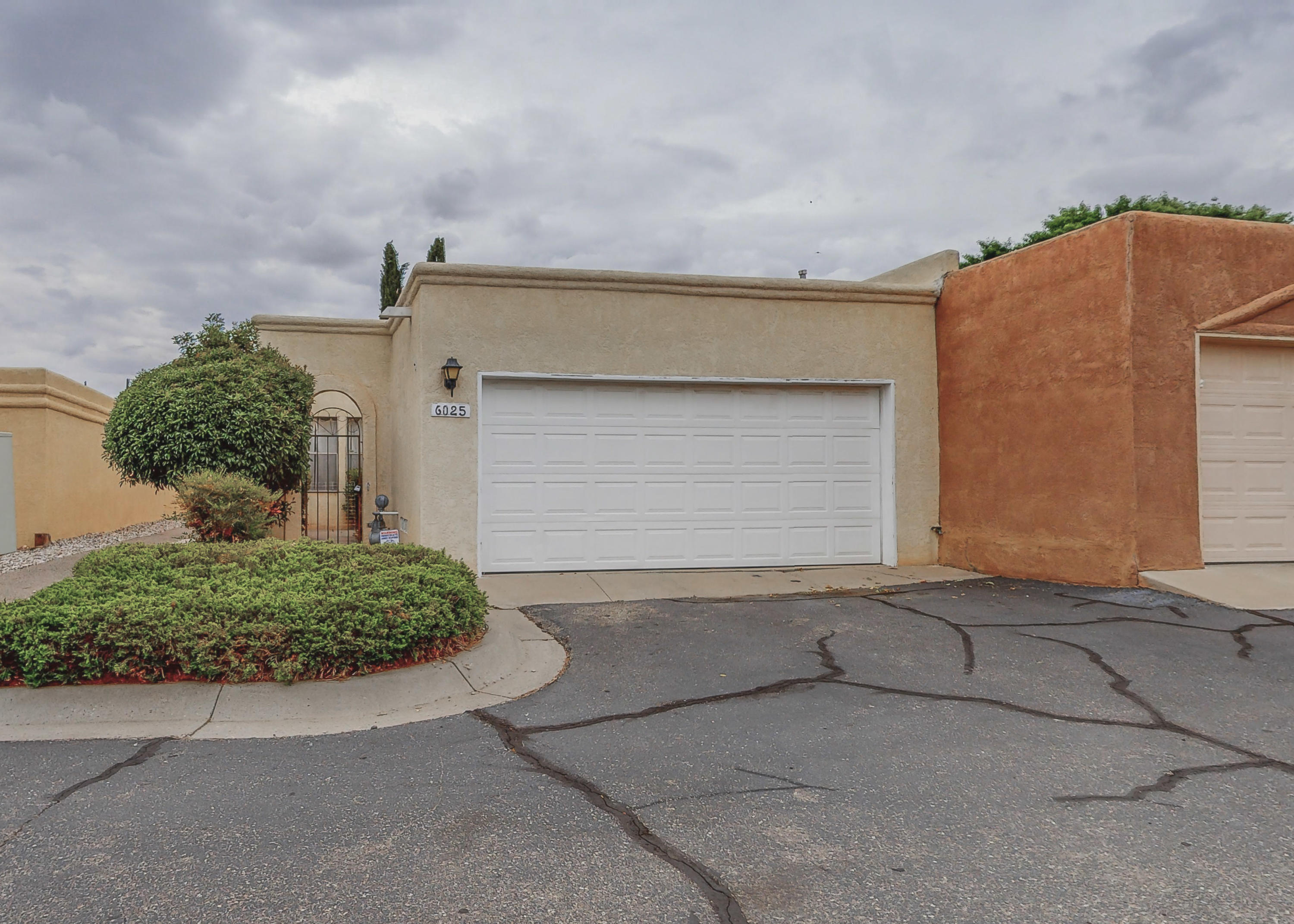 If you're looking for a low maintenance and relaxing lifestyle, you just found it! This lovely Townhome is only attached on one side (east side) and located in the desirable Chimney Ridge community, close to Arroyo Del Oso Golf Course. Restaurants and shopping nearby, easy freeway access and all that the Northeast of ABQ has to offer.  This 2 bedroom, 2 bath home features Refrigerated air, a remodeled modern kitchen, ceramic tile flooring, skylights, brand new carpet, fresh interior paint, cozy wood-burning fireplace, low-maintenance patio/backyard. All appliances stay including front-load washer/dryer.  HOA covers water, trash removal, exterior stucco, roof, front landscape, common areas including pool, tennis court and clubhouse. All units are owner-occupied-no rentals. Come take a look!