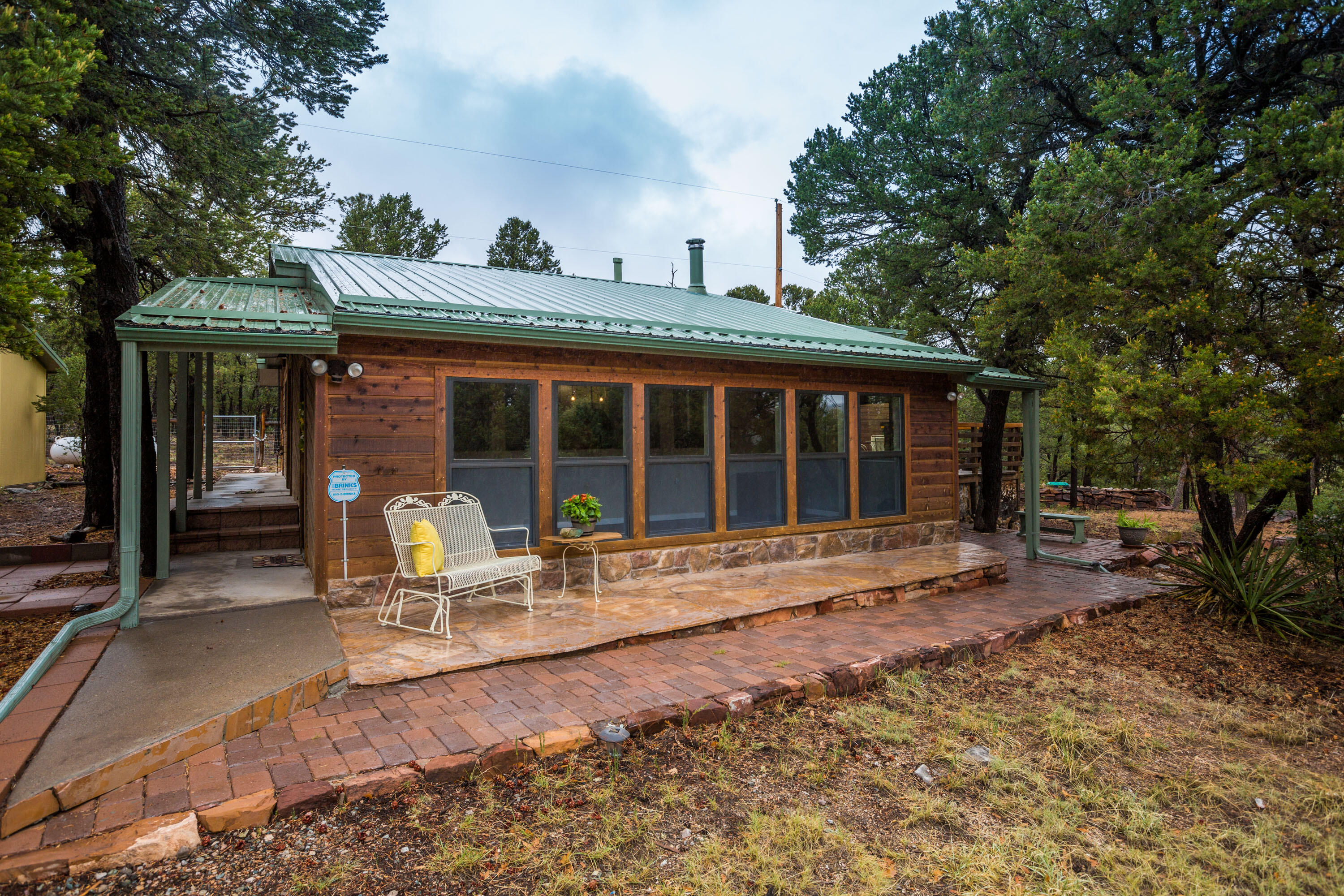 This is the remote cabin retreat you've been waiting for. Nestled on two (fenced) acres, backing to national forest, this property is mountain-living at its finest and still only 20 min from ABQ. This home has been loved by its current owner for 14 years and was just completely remodeled for its new owner. The kitchen boasts custom cabinetry, high-end granite, all new stainless steel appliances, and will have a new backsplash (not pictured). Both bathrooms have been beautifully updated, new hardwood floors and carpet throughout. Mechanical upgrades include: all new pex plumbing, updated electrical, pro-panel roof (with R60 insulation), solid core doors, new water heater. Great internet! Need a shop? Enjoy the 3 car garage with perfect workspace. Its rare to find a home this updated.
