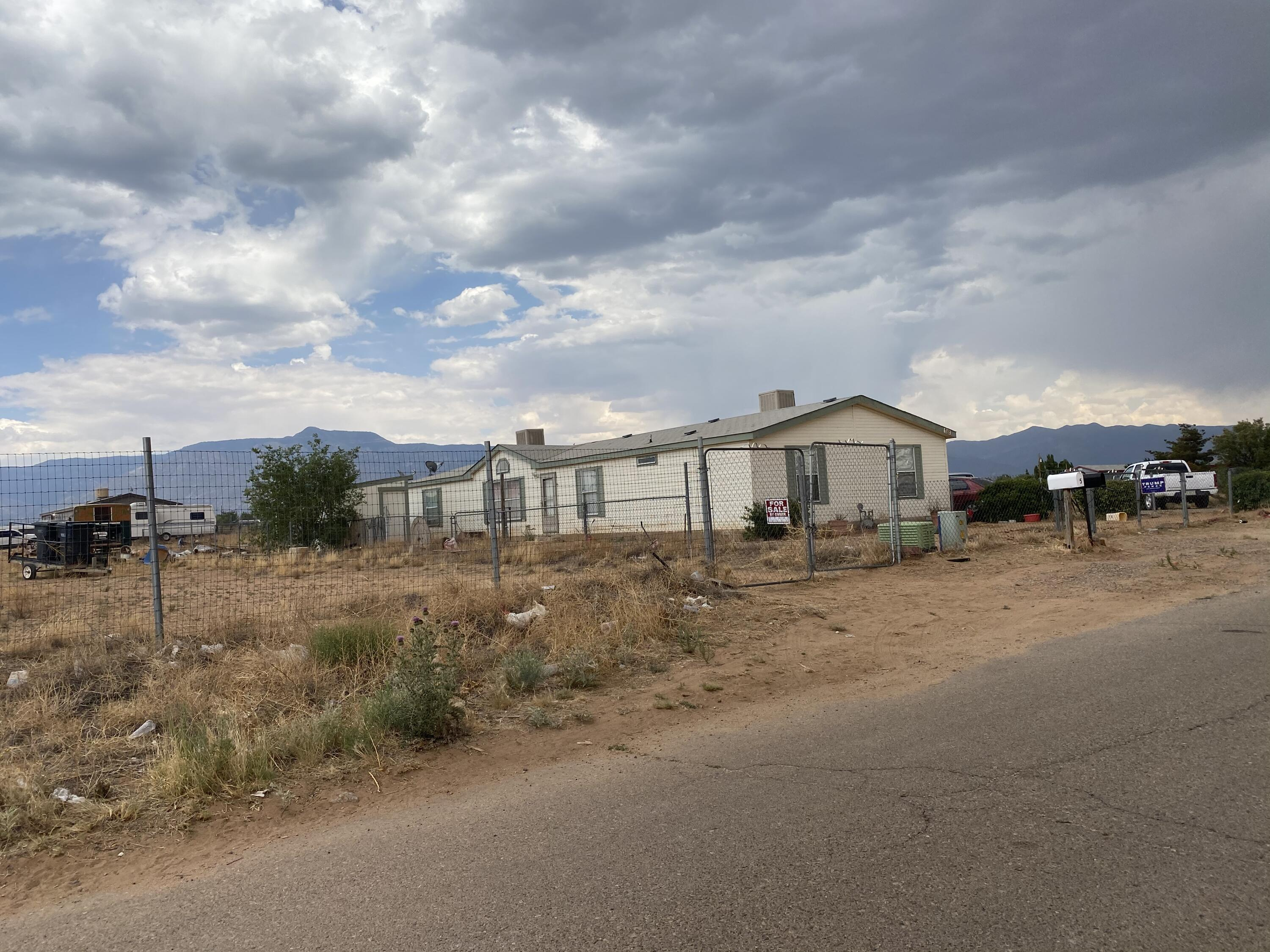 If you are looking for space look no further this 4 bedroom will fit all your needs country living not to far from town, with only 10 minute drive from Los Lunas main street, with enough land to play you don't want to miss out on this spacious home today! schedule a showing today.