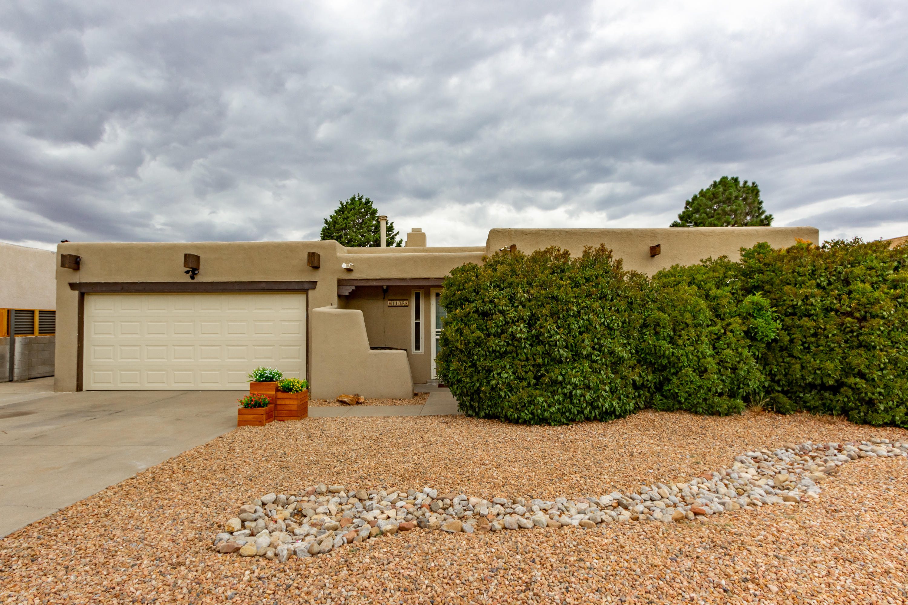 You will feel an abundance of love and care in this home as soon as you drive up.  Second owners have made this property shine. Newer rubber membrane roof! refrigertor air with smart thermostat. Updated flooring, new carpet,  and fresh paint inside and out are a few of the recent updates. Backyard access with plently of room to park an RV . If you're looking for a PRIVATE green backyard oasis look no further. New decking on sun exposed area making this space ready to entertain. Set up a showing before it's gone. Open House Saturday 1-4pm!