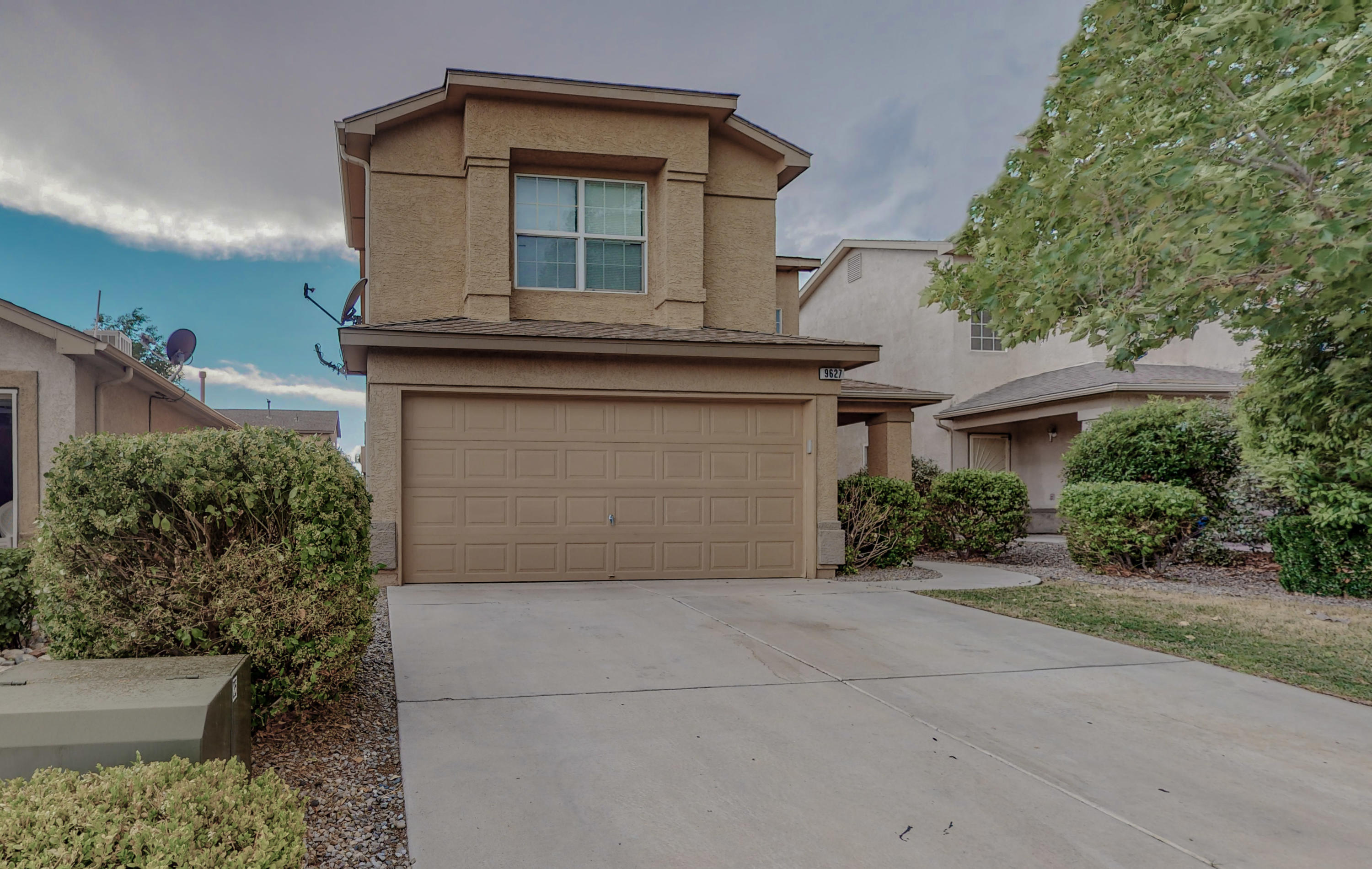 Gated Community in a beautifully set neighborhood.  Lush front landscape, tile throughout the main floor. Greatroom with fireplace and high ceilings. Upstairs loft for second living room, hobby room etc. Balcony off master, garden tub, separate shower. Newer Refrigerated air, newer furnace and newer water heater installed in 2020.