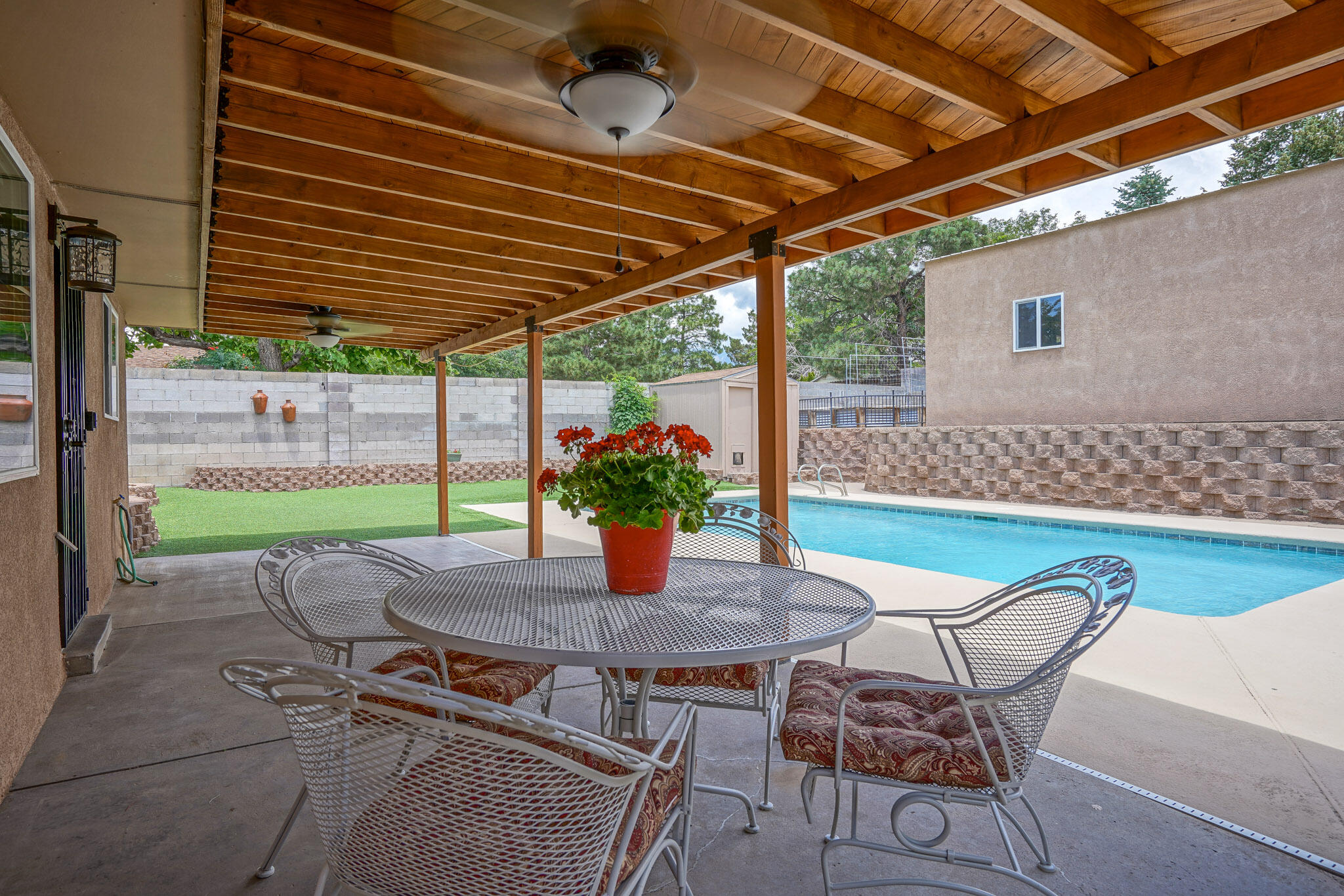Hidden gem alert!  Lovingly and thoughtfully renovated by the owners (not a flip) one level, 4 bedroom home with a sparkling heated swimming pool, covered porch, huge double insulated bonus room, detached oversized garage / workshop with alley access via heavy duty rolling gate. Irrigated gardener's mecca raised bed gardens and mature blackberries & Maximillian Sunflower bushes. New roof in 2015 with 45 years left on warranty. New Vinyl Plank flooring! Granite kitchen countertops! Double pane high end Pella Windows! Great room Fireplace wood insert, clean burn catalytic convertor heats 1200 sf. Refrigerator in detached workshop can stay! Highest energy efficiency HVAC. Auto sump pump near pool for storms and overflow drainage. All offers will be reviewed Monday July 12th! More info online!