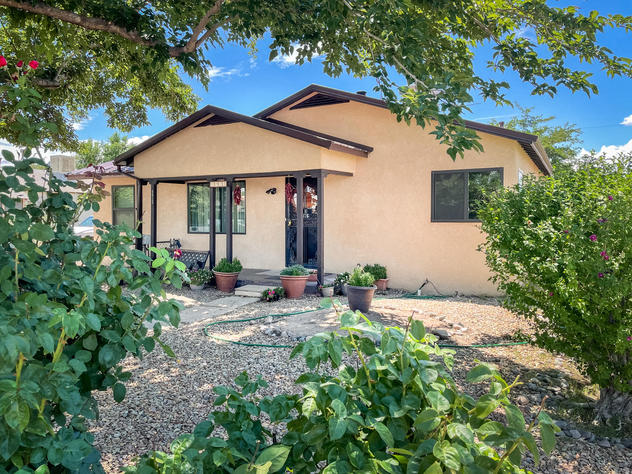 Lovely North Valley gem. A beautiful custom made door greets you as you enter. New pro-panel roof in 2019, furnace and water heater about 8 years old, and evaporative cooler about 4 years old. HUGE living area with bay window and view of the shaded front yard. Newer laminate flooring.   2 living areas for entertaining. Large kitchen with tons of storage, stainless steel appliances and granite countertops. Great sized backyard with shade tree, apple trees, new xeriscaping and shed. Great 10x12 covered wooden deck. Great location, close to shopping and easy access to I-25. Won't last long!  Come get your piece of the valley!