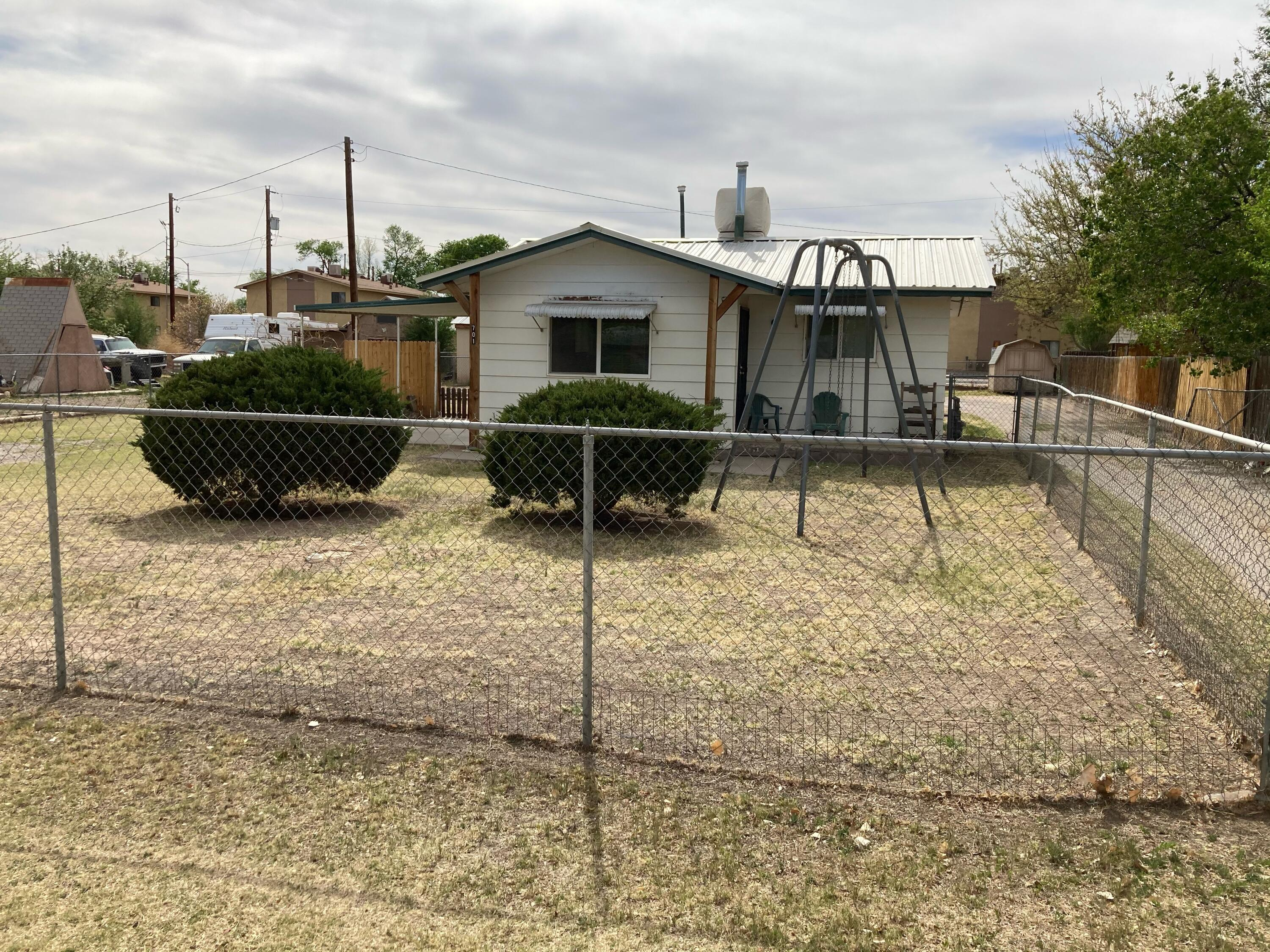 Great investment property in the heart of Los Lunas.  Two houses on .29 acres.  Front house has 627 sq ft, 2 bedrooms & 1 full bath.  Back house has 608 sq ft, 1 bedroom & 1 full bath. Each unit has its own access.  Live in one unit and rent out the other!