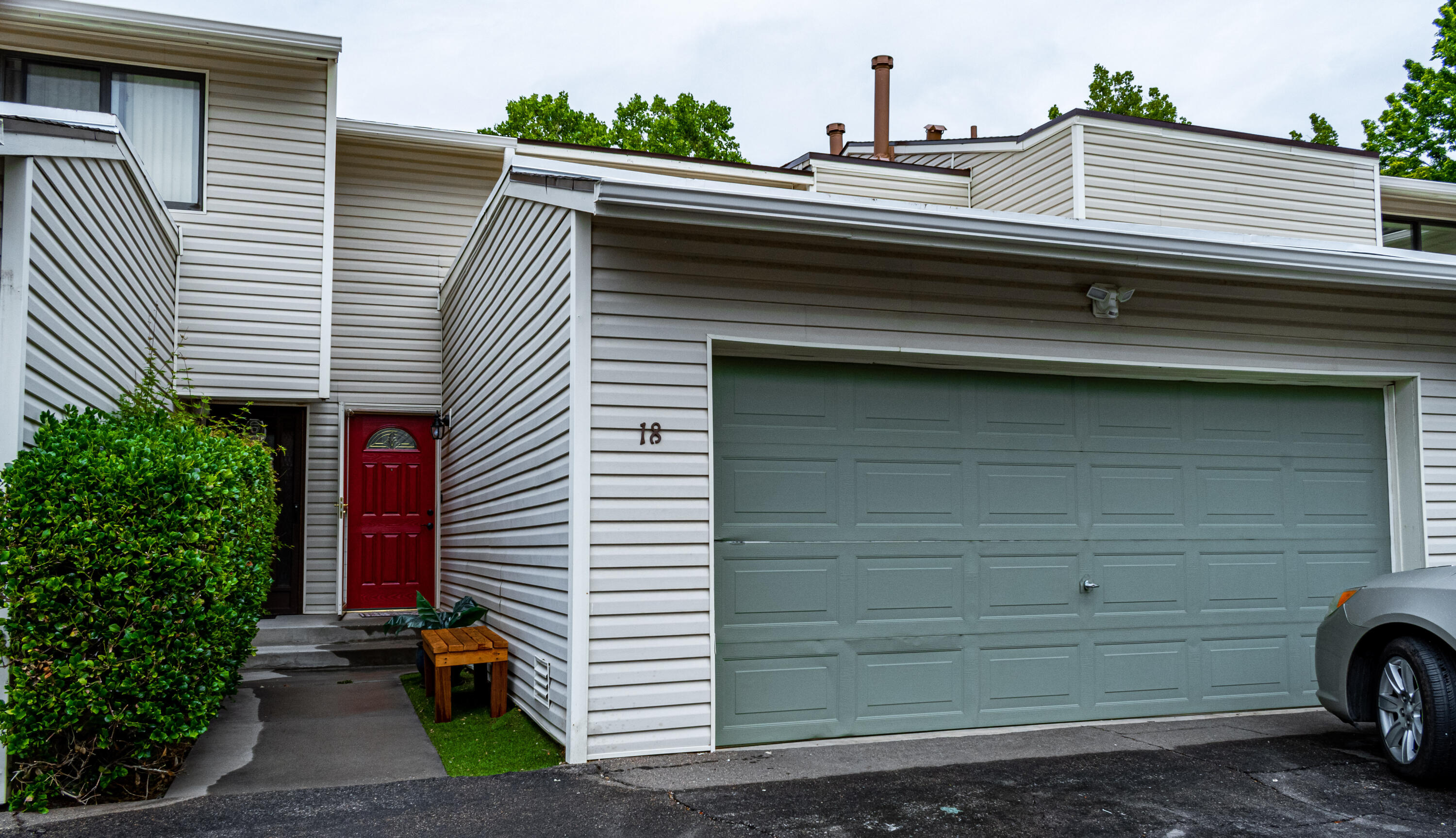 Fabulous, stylish townhome in the beautiful Shores Community. A cozy, chic and sensible 2/possible 3-bedroom retreat, centrally located with super easy access to ABQ Uptown. Back patio overlooks lush, grassy hills with mature trees, lakes and fountains... and you don't have to maintain ANY of that landscaping! Brand new TPO roofing. Refrigerated air, hardwood floors,  nice bright foodie's kitchen with 2 pantries, finished basement space could be large 3rd bedroom, recreation room or second living area. Extra features include WIFI controlled thermostat (Ecobee), bluetooth speaker in bathroom lights. Community amenities include pool, 2 tennis courts, clubhouse, mini golf. All appliances convey. Flooring allowance may be considered with strong offer. Come see it today!