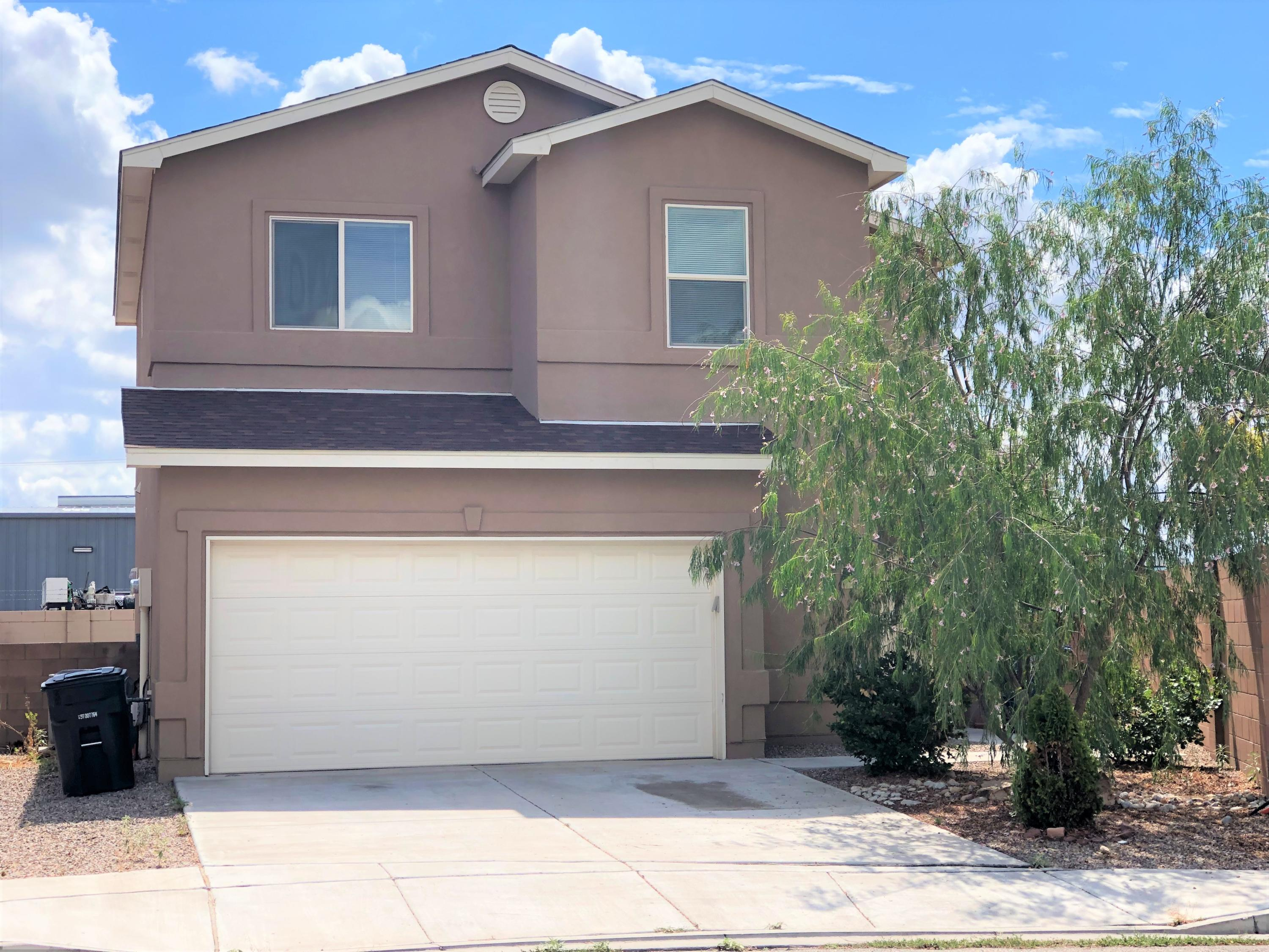 Welcome to this well maintained home located within walking distance across from West Mesa HS in a quiet neighborhood.  Conveniently located next to I-40 freeway, close to shopping and restaurants.  3 bedrooms, 2.5 baths, open floor design with kitchen island and stainless steel appliances. New floor was put in 2020. Raised ceiling and refrigerated air will make the summer days super comfy.  Master bedroom comes with large walk in closet.  Washer and dryer stay with the sale.  This is a gem, don't wait to schedule a showing.