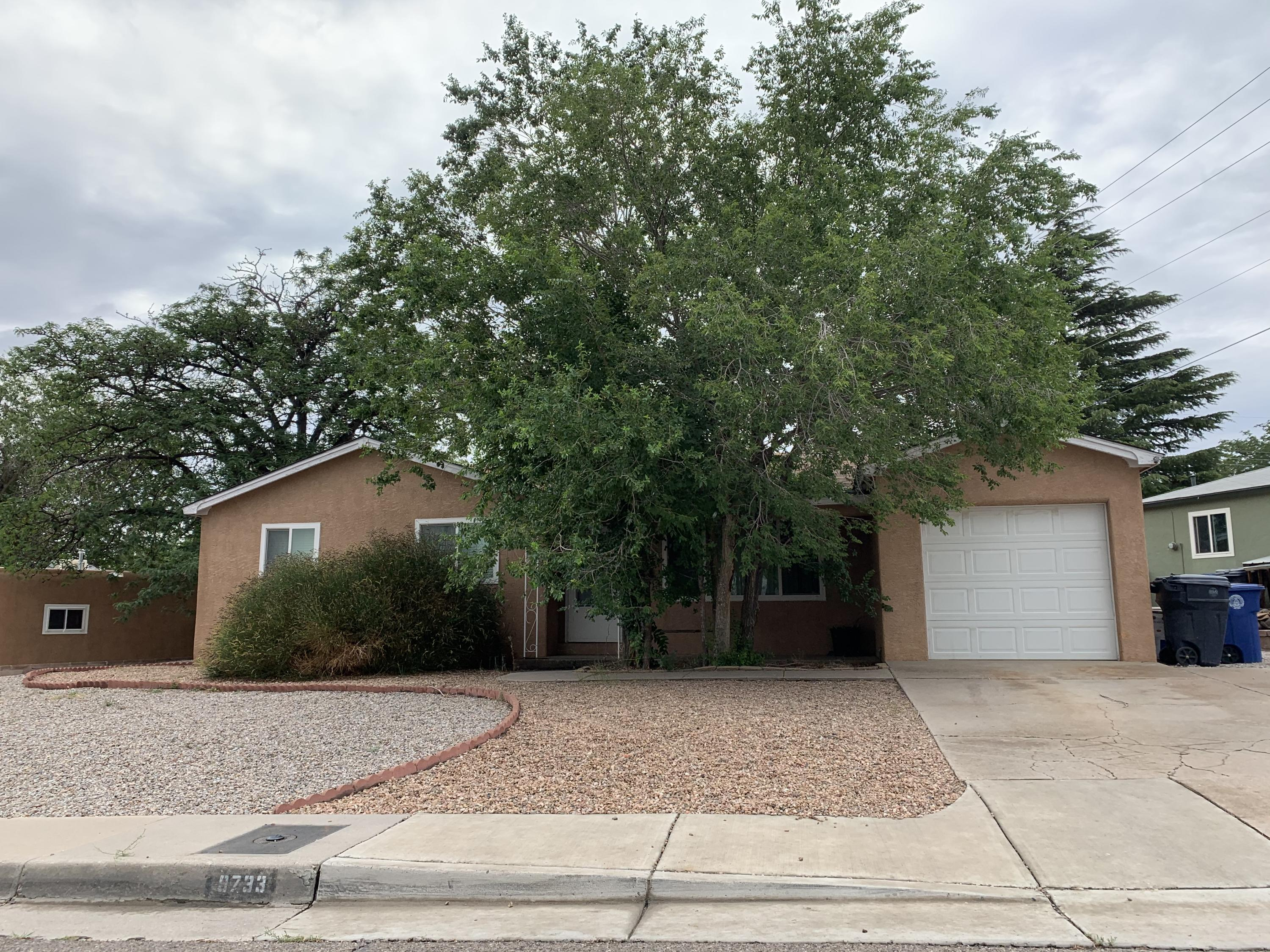 NEW PRICE!  Finish what the owner started... features some updates.  Popular NE Heights neighborhood with large lot close to schools and park.  3/br, 1.75/ba, 1 car garage.   Selling AS IS.