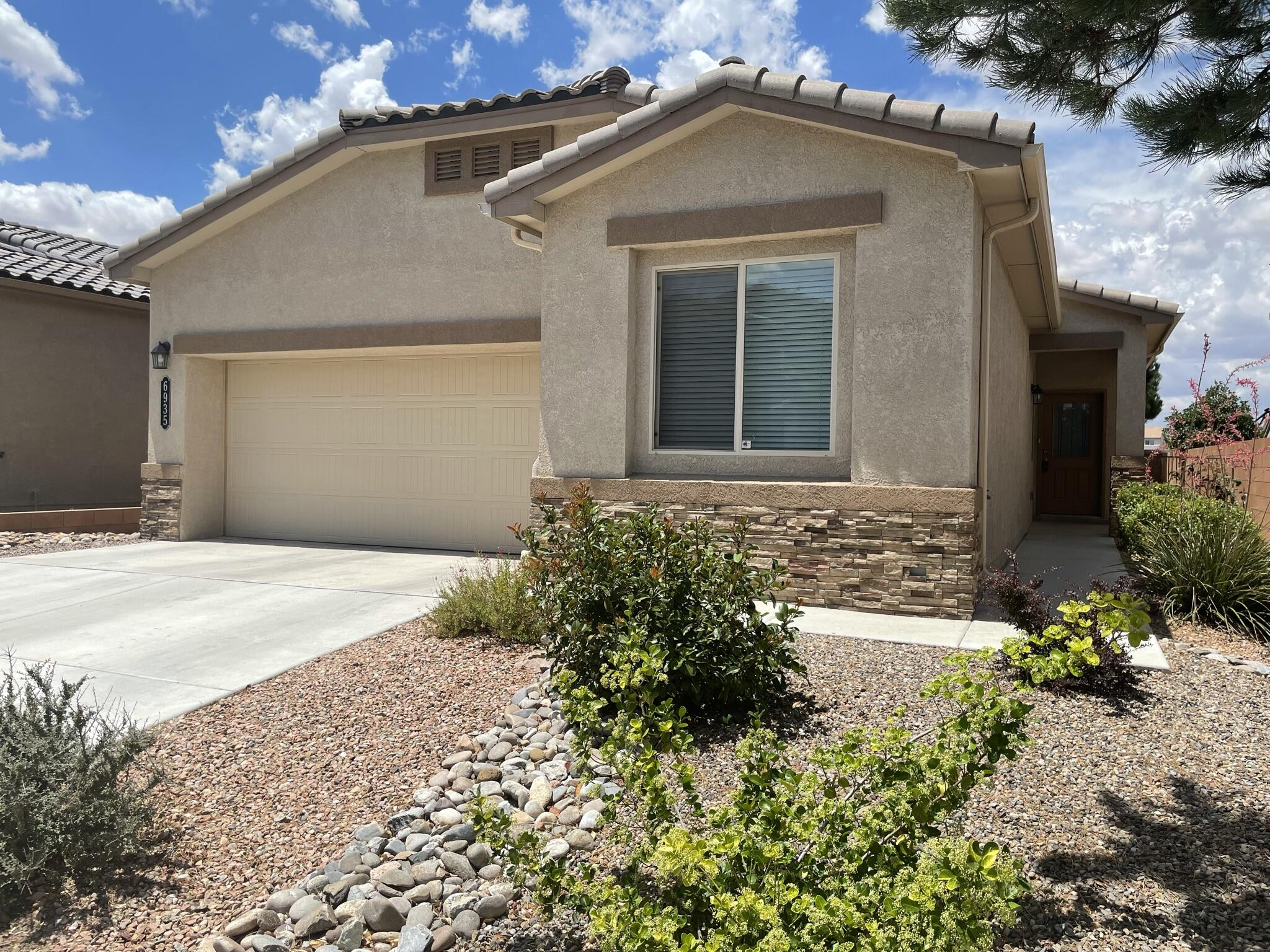 Built in 2016 and Previously DR Hortons Fully Loaded Model Home!  Energy Efficient Green Certified NM Bronze, HERS Score: 70! 2x6  Construction! Stone Accents! Refrigerated Air! Stone Rear Patio! Tall Ceilings! Tankless Hot Water Heater! Granite! Tile & Carpet Flooring! Walk-in Closet! Dual Lavs! Garden Tub! Laundry Room! 3 Bedrooms Plus an Office! Finished Garage!  Beautifully Xeriscaped Front and Back! Walking Trails / Parks Nearby! All Appliances Stay! This Home is Beautiful and Move in Ready!