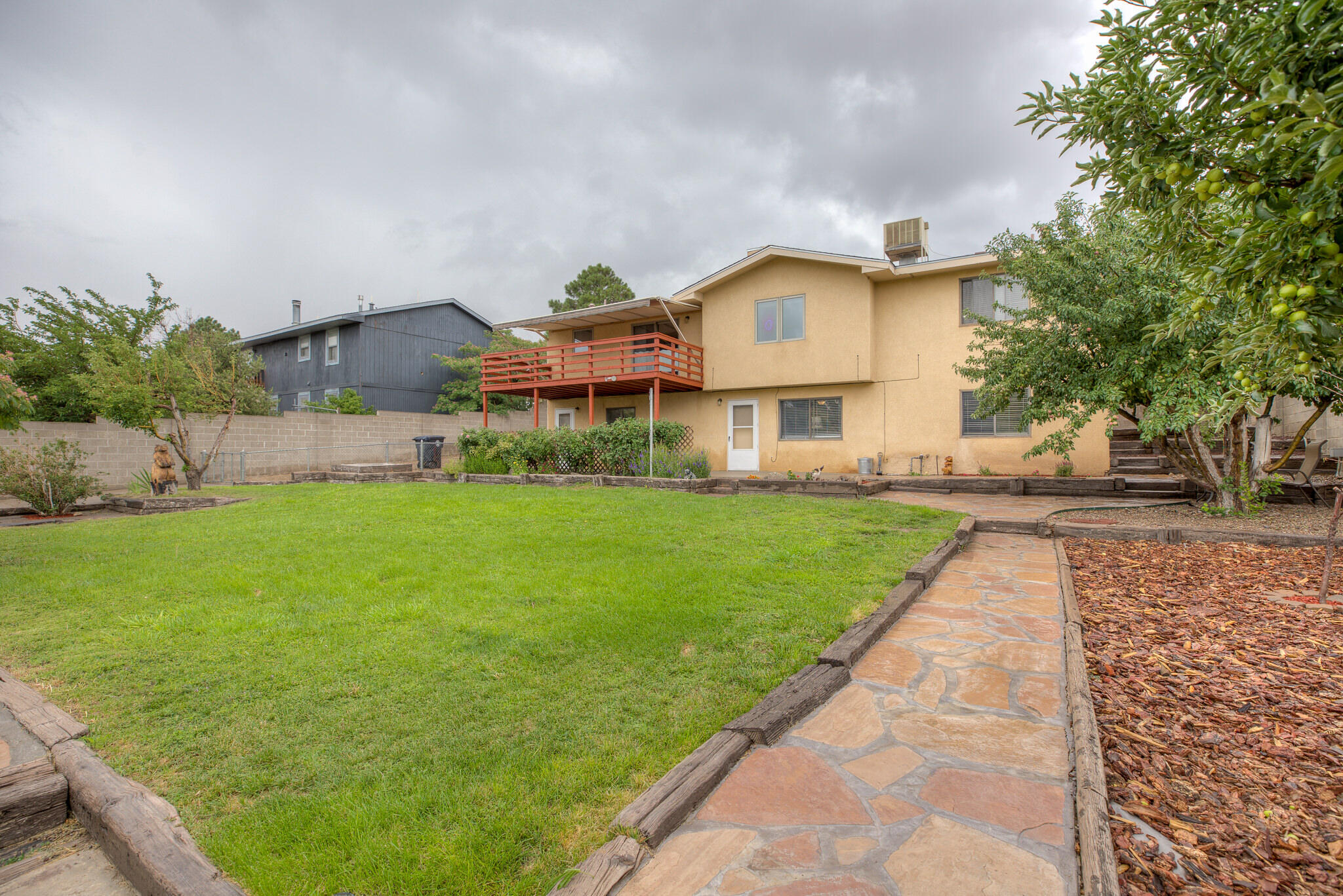 PRICED TO SELL!!  Nestled at the base of the foothills and hiking trails, this home has 2 MBR's  (perfect teen/inlaw). 3 BR's up, MBR down, 2.75 bath, large pantry/safe room, office not counted as BR, Massive Laundry with storage, 3 RV pads, not including drive, Landscape front and rear, Upper deck with awning for great City View, BBQ/dining, complete with fruit trees, 2 patios, 2 sheds, working Jacuzzi, in a quiet setting, yet great for entertaining!   Very deceiving from the front.