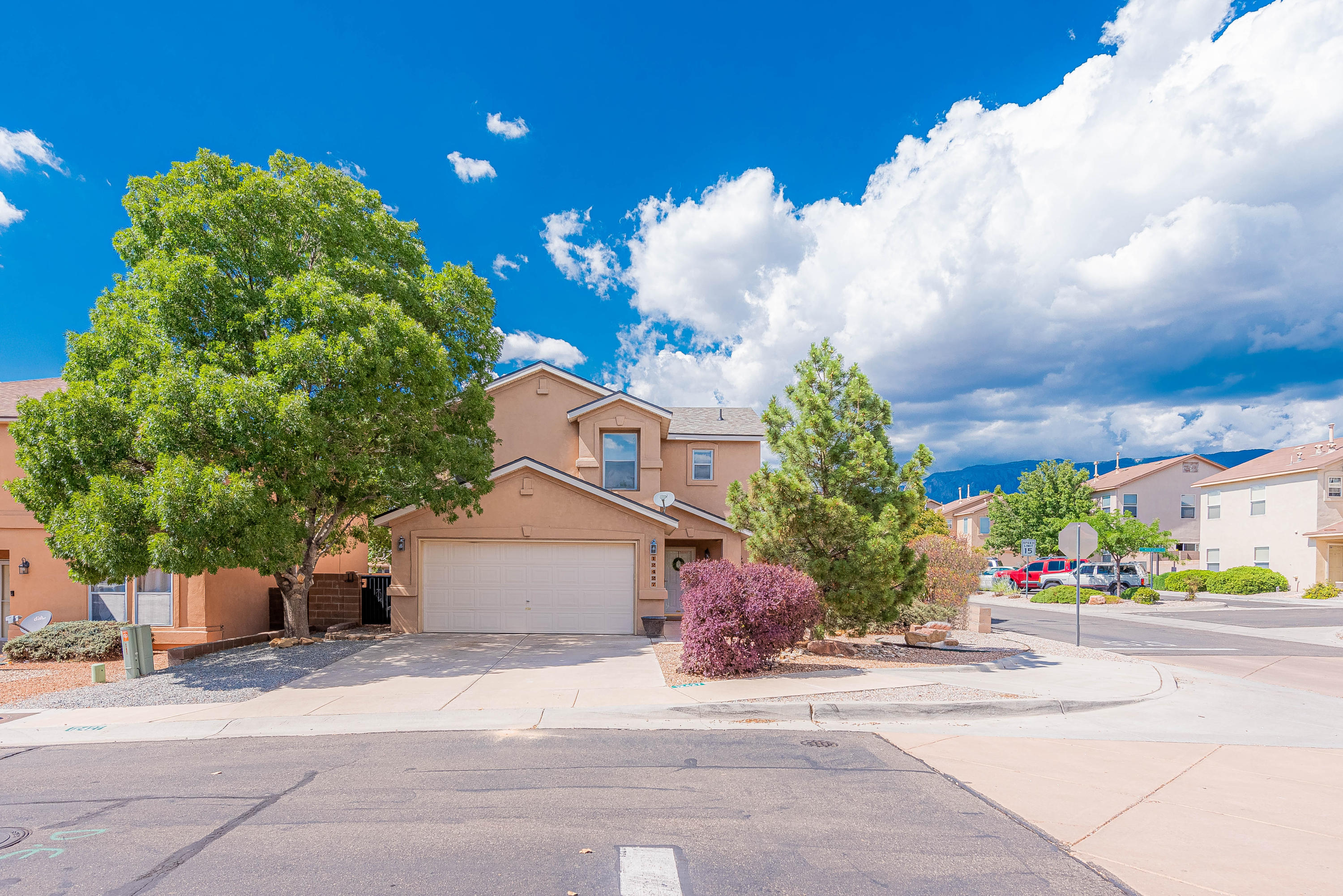 Fantastic home in the NE Heights! Open floor plan with lots of natural light. All appliances stay including washer/dryer and extra fridge in garage! Great views and comfortable backyard with TWO covered patios. New roof has 20 year warranty!
