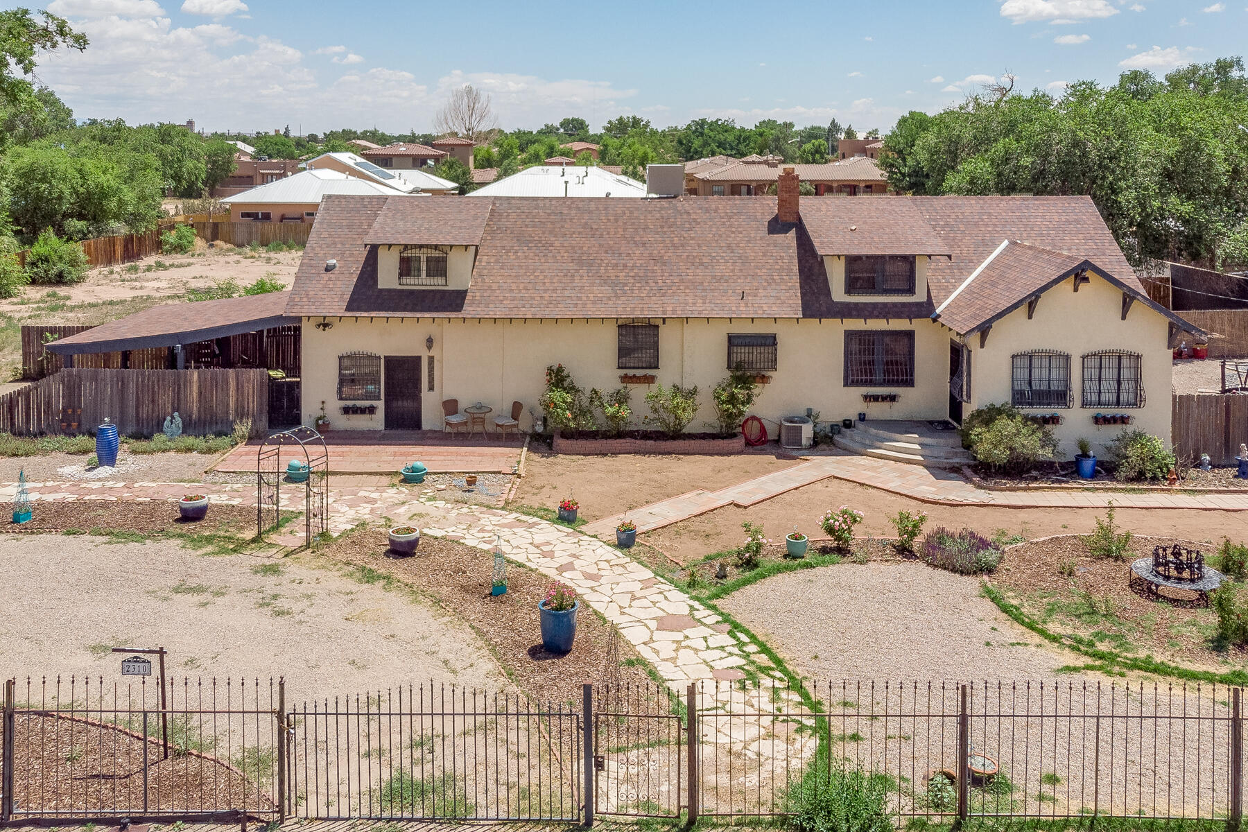 Don't miss your opportunity to own this historic treasure on over an acre of land in the North Valley! There is plenty of room to build and with zoning classification R-A this is a unique investment opportunity in a prime location. Not only does this custom home offer 5 bedrooms, 4 bathrooms, 3 living areas and 3320 square feet of heated space, it also offers a 945 square foot basement AND 122 square foot enclosed sunroom. Enjoy entertaining under the enormous, covered patio with built-in grill. This home has a fun blend of authentic historic features such as original skeleton key doors and hardwood floors mixed with modern conveniences like the updated kitchen. Keep comfortable with various heating and cooling sources (refrigerated air for the lower level, evaporative cooling for the