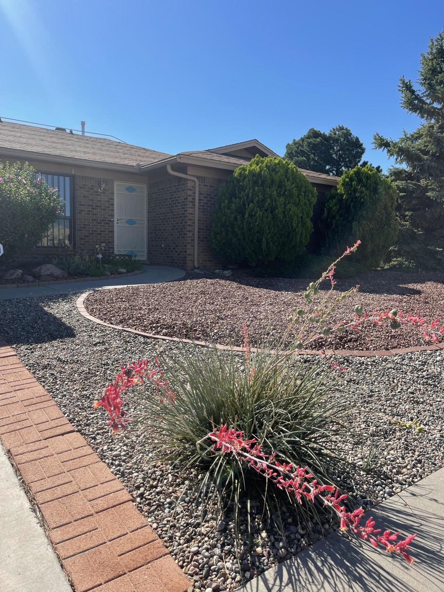 WELCOME HOME to this beautifully maintained, manicured home near the foothills. Owned Solar, refrigerated air unit is newer and heater and roof are approximately 4 years old. You will enjoy the evenings in the mature backyard landscaping under the covered porch. The floor plan provides options galore and open, bright spaces to meet your needs.  Garage has increased depth and the extra workshop space is wonderful for storage or toys! Enjoy hiking, biking and living in this desirable neighborhood.