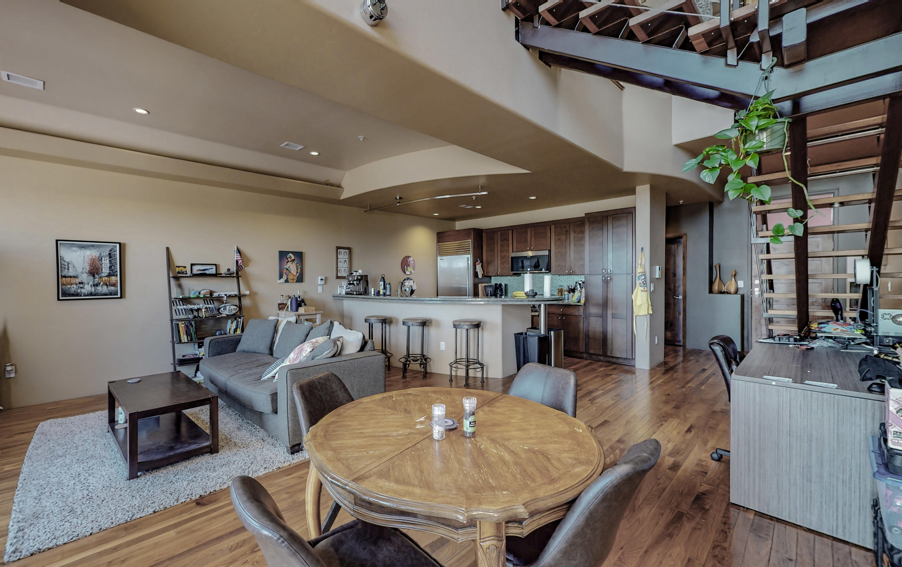 This could be one of the nicest condos that has been listed for sale in Albuquerque!  The location is perfect as it is on Central in the heart of Nob Hill, the entertainment center of ABQ.  Situated in The Place in Nob Hill, this modern loft style condo boasts an approximately 581 square foot rear deck with views of the Sandia Mountains!  Additional features include:**Granite Countertops**Upgraded Wolf Appliance Package**Real Wood Floors**Urban Architecture**Open and Airy Floorplan**Tons of Natural Light**Private Tandem 2 Car Garage**This condo is great for entertaining!  Please schedule your private tour with a realtor today...