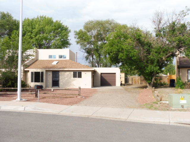 Fantabulous home in the northern end of the Village of Los Lunas with a rural setting. 2 bedrooms, 2 baths, family room, living/dining room comb. Refurbished custom wood cabinets. New marble counter top w/back splash. New flooring, new windows, new roof, new heating & new refrigeration unit.  New synthetic-stucco., all new electrical receptacles, all new paint, new skylight and all new knotty pine doors. Nice secluded, shaded back yard with covered porch. Turn key, move-in ready. To include a one year Home Warranty of up to $500.00.