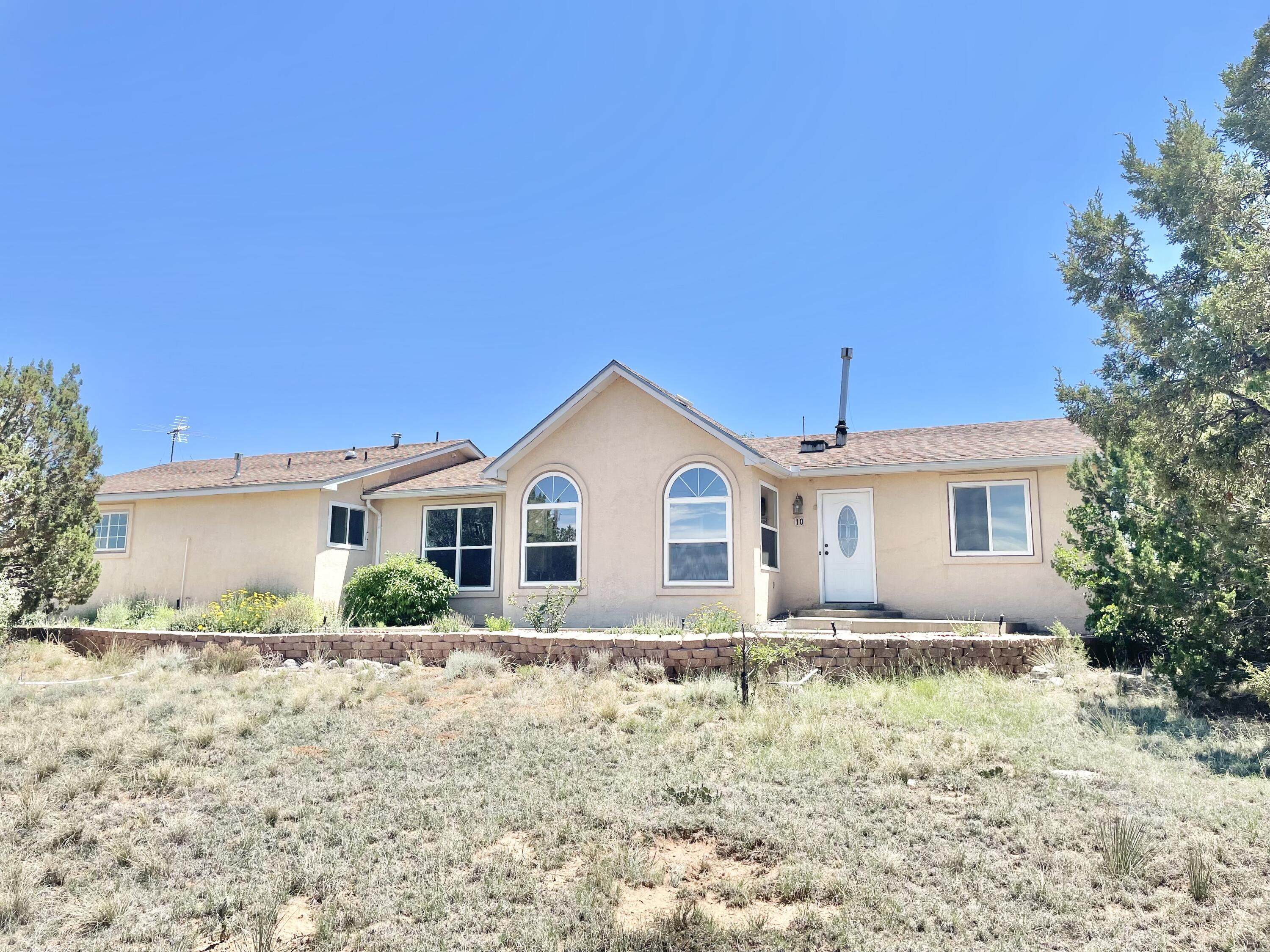 Listed below market value for a quick sale.  Right in the heart of Edgewood.  Great Views, Lovely Landscaped yard, just over 2 acres. Private walled back courtyard. Two Living areas, family room has cozy woodstove. Master has gorgeous Master Bathroom.  Close to Shopping and access to Albuquerque.