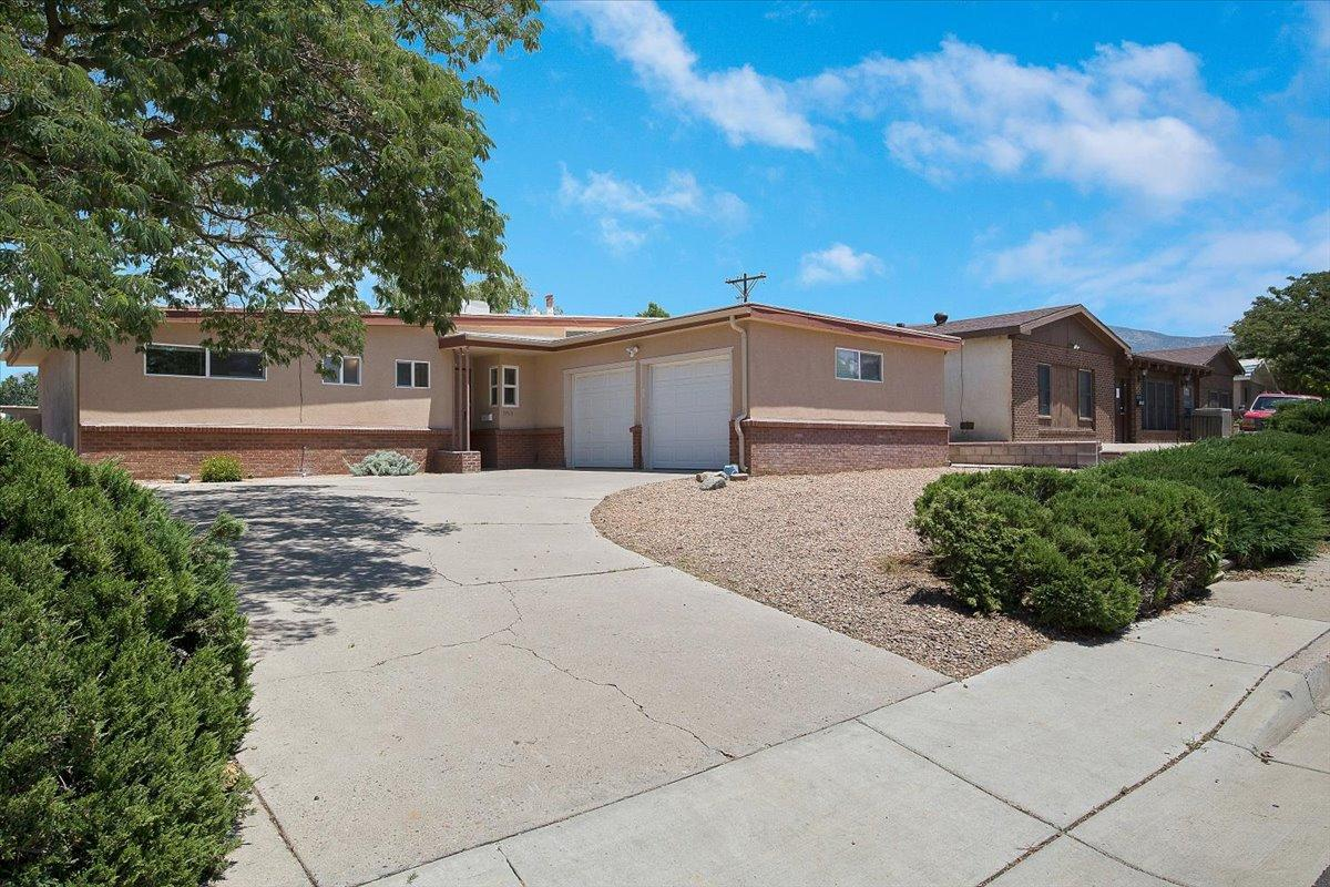 Welcome to you new home, this one has been well cared for and is ready for you to move in and enjoy.  Updated kitchen is open to the spacious living area with corner fireplace and access to the back yard with incredible unobstructed mountain views. LVT plank flooring in the living room and hall, plush carpet in all 4 bedrooms.  Lots of updates including newer garage doors, windows throughout, front stucco and heater all in the last 4 years. TPO roof and master cool 10 years old.