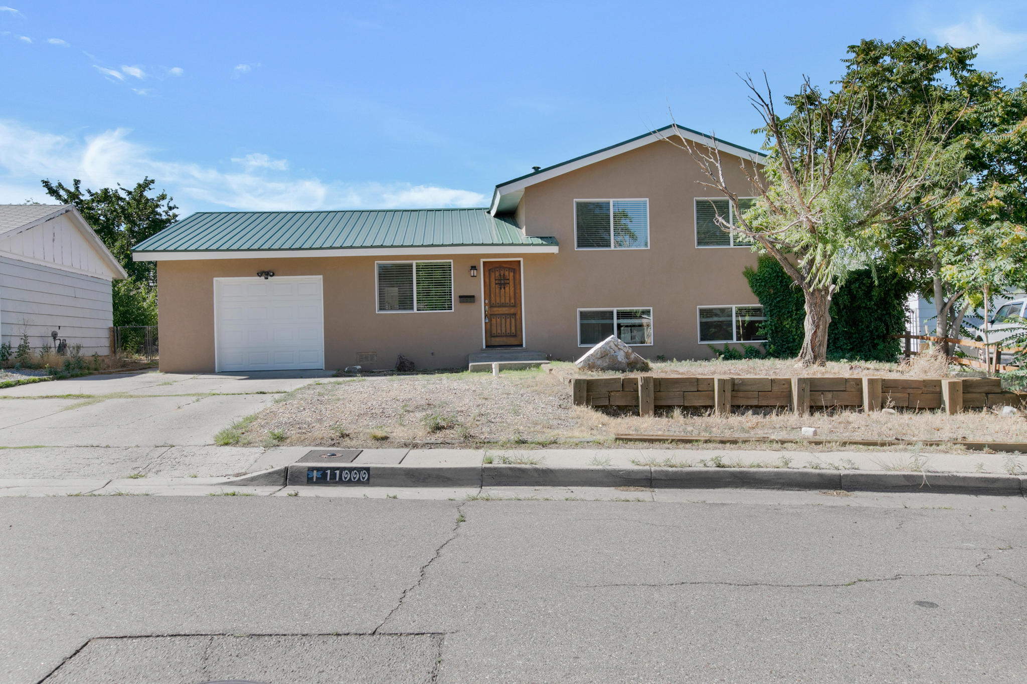 Very Nicely updated Split Level Beauty in Far Snow Heights.  Gleaming, refinished wood floors Sparkle in the Living, Upper Hall and all Bedrooms. Tile in Baths & Kitchen with Carpet in Family Room Below. Recently remodeling that included a new Metal Roof, Vinyl Windows and Stucco Too!. Quality Interior Updates to all Baths, Kitchen Cabinets, Fixtures, Doors and Hardware.  The Cozy Country Kitchen includes Granite Counters, Large Single Basin SS sink and SS Appliances, including the Refrigerator. The Massive Family room with a full bath takes up the entire lower level and could be spilt into a Bedroom and a Family room with ease. Newer Furnace and Refrigerated Air complete the Updates.  There is a 260 SF Covered Sun Porch and a separate Shed.  Don't Miss Out on this Great Home.!!