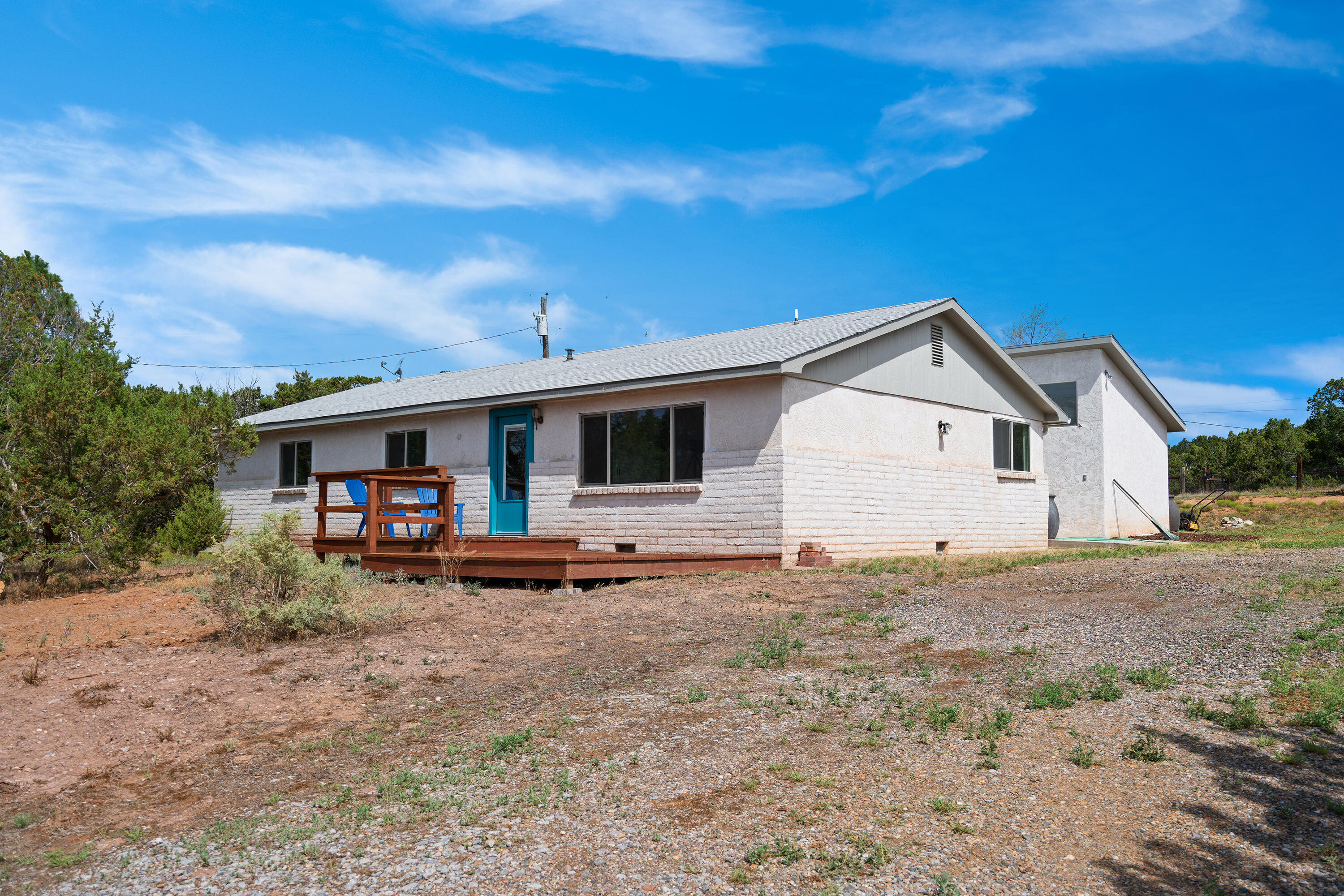 Beautifully updated home in the East Mountains. Spacious open floorplan on 2 aces  wooded views.  porch, rustic  Dining area and breakfast area in kitchen with island. Laundry room.  large main suite, and beautiful laminate flooring throughout. This property offers plenty of space to add additional storage and or a barn. come see this one today.