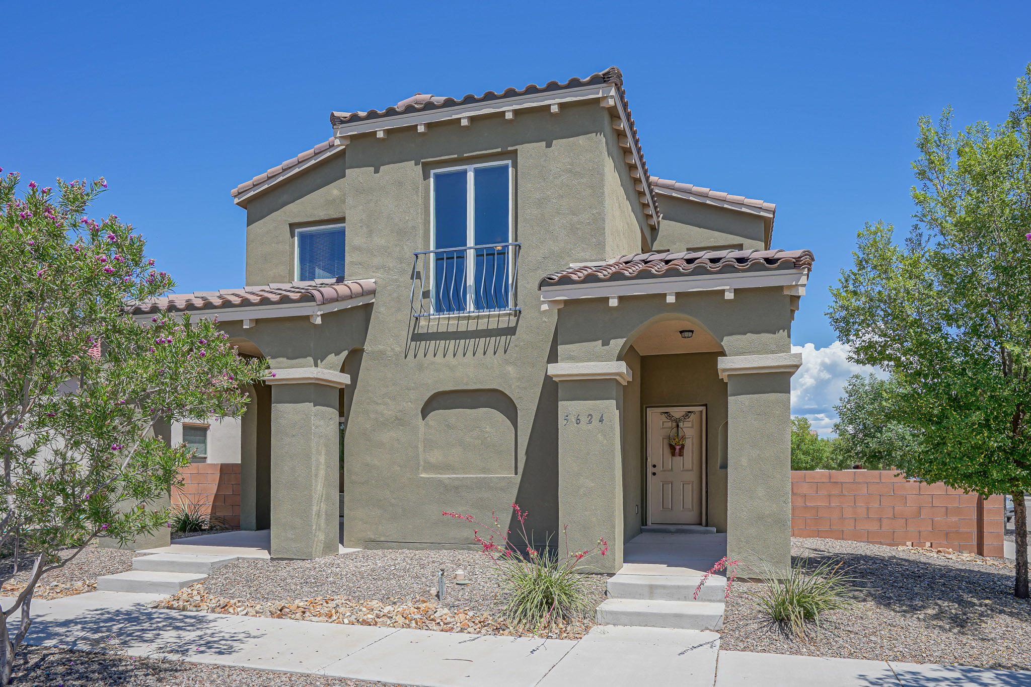 Enjoy a sweet, quiet community in Mesa Del Sol just a skip away from the busy city! Relax at the sparkling community pool or BBQ at the beautiful park. This Raylee Devotion Model is rated Silver Green for excellent energy bills and a HERS score of 54. The corner lot gives extra privacy in your 2 separate patios and a lovely balcony with beautiful views from the master bedroom. You'll love the open floor plan with a roomy loft upstairs! The Jack n Jill bathroom opens to one bedroom and into  the hall for guests or easy access. The spacious master has a large bathroom with double vanities and a shower. Plenty of storage space in this home with mostly walk in closets. A few other perks: Tankless water heater, pull outs in the kitchen cabinets and all appliances convey with the home!