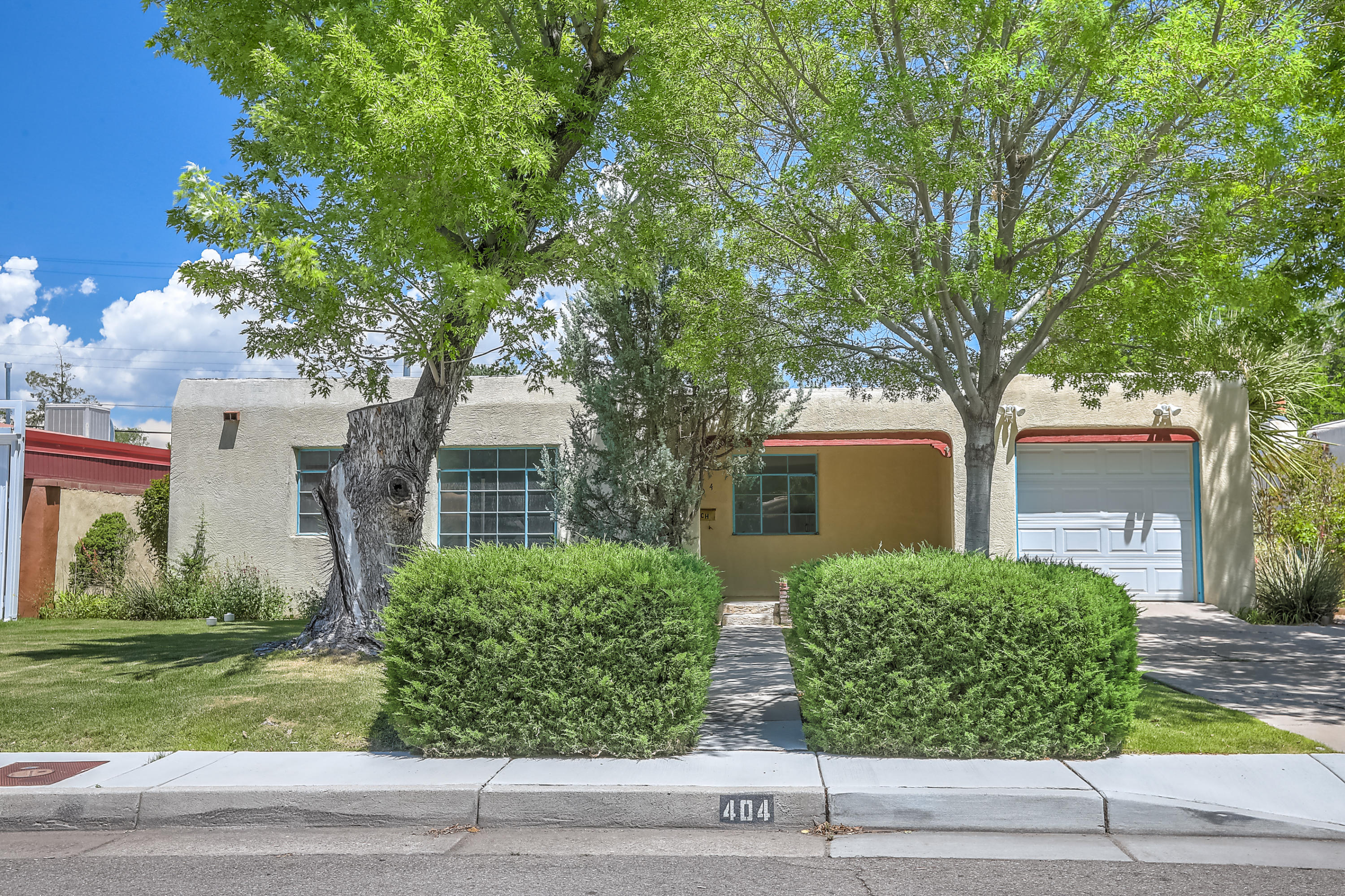 Location, location, location! Walk to Humble Coffee, Nob Hill, and so much more! This charming UNM area is a single owner home and its time to pass it on to another family. With 4 bedrooms and 2.5 baths this home offers plenty of space. The primary bedroom has a 3/4 bath and is separated from the other bedrooms. 3 additional bedrooms are spacious and one has a half bathroom. The den off of the kitchen is a great space for entertaining with the fireplace and large windows for natural light. Enjoy the backyard patio space with roses and other mature landscaping. There is a single car garage with a workshop space as well. This location cannot be beat!