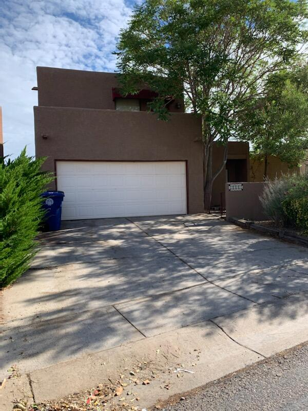 A truly beautiful patio home with panoramic views of the Sandias and City Lights. Open walking Trails behind the property . Very private back yard with deck with plenty of greenery . Super close to the elementary school . Stucco has been worked on and repainted, yard has been spruced up . this home has a bonus room on the bottom floor office/library play room with separate entrance. New stucco that includes a 3 year warranty.