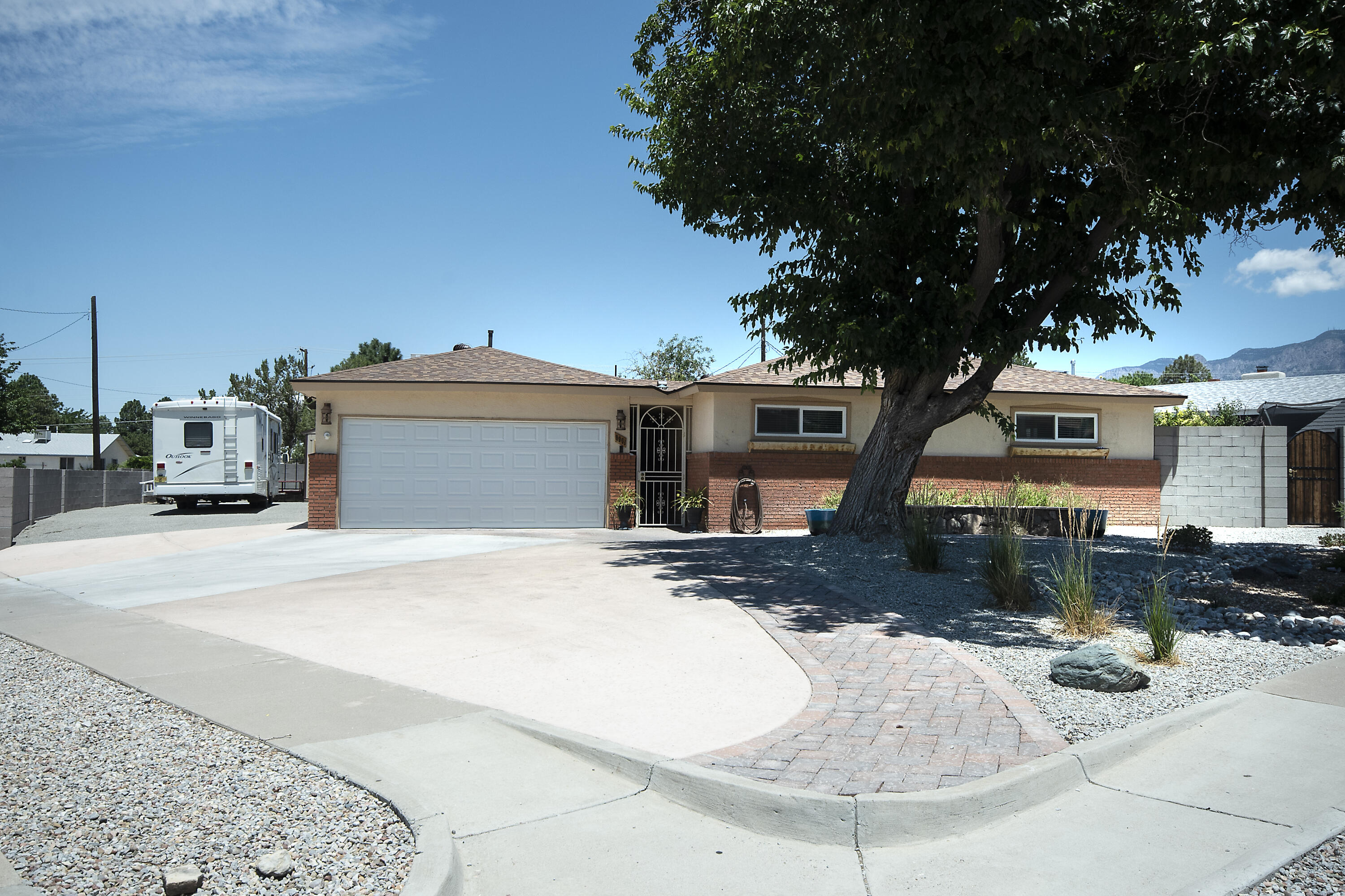 This home is TURN KEY! Located on an oversized corner lot. The Sellers have done all the remodel work for you. This open concept, modern farm house is super clean and ready for it's new owner. The home is very bright with tons of natural light. The kitchen has new appliances to include double ovens, beautiful granite countertops, white cabinets and laminate floors. Guest Bathroom and Ensuite Bathroom are also stunning, white and clean! Owners Suite has been updated and includes his and her closets, private seating area and gorgeous oversized shower with separate tub. The side yard access is perfect for storing an RV or Boat! The Backyard is beautiful with trough garden beds, grass, trees, play area and covered patio.