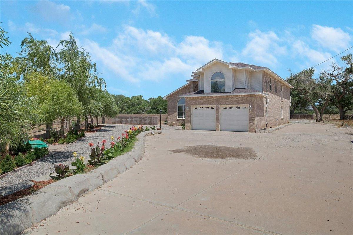 Fully remodeled, custom ranch style home. Sitting on 1.5 irrigate-able acres. Features an open floor plan, with a gorgeous chefs kitchen, a walk-in pantry. Featuring stainless steel whirlpool appliances and granite countertops. Ready to entertain friends and family. High 20ft ceilings in both living rooms giving a luxurious grander. The smart thermostat controls the refrigerated air right from your phone. The two car garage comes equipped for a 220v electric vehicle charger. The almost 1000 sqft workshop is a mans dream. Come by and fall in love with this home.