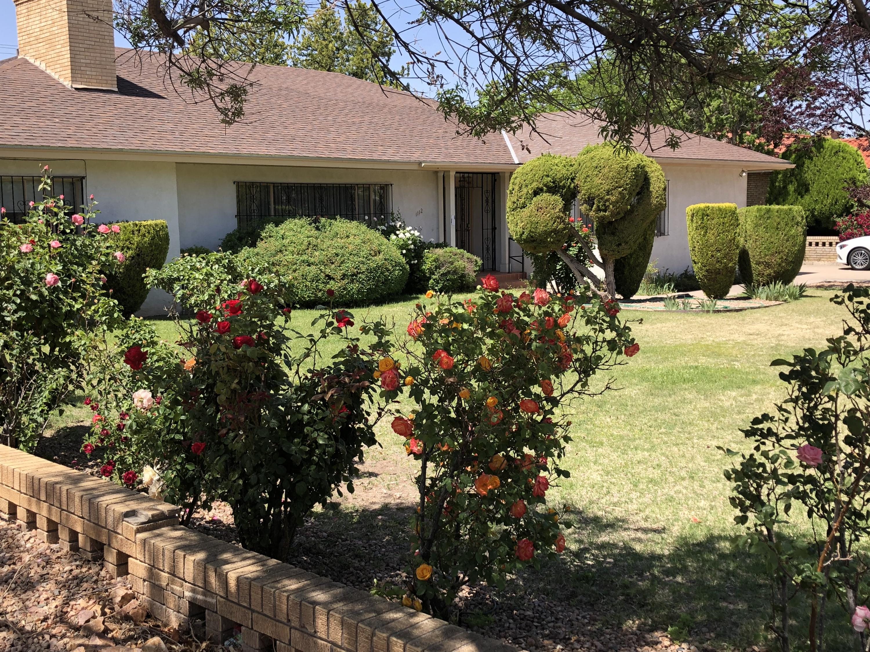 This charming University neighborhood offers the beauty of mid- century architecture with a great location.  Built in 1953, this custom home features many of the original amenities including a 10' coved LR ceiling, plaster & lath walls, glass pocket doors  separating the formal living and formal dining room.  There's even a swivel  built-in bar in the dining room. The hall and master baths reflect the 1950s feel with the original tile and flooring, shower & bath surrounds.The Master Suite is separated from the other 4 bedrooms and features a full, mirrored dressing area, walk-in closet system designed by California Closets & the original bathroom tile work. and many of the 1950s light fixtures.  The other amply sized BRs are located on the opposite side of the house.,(SEE MORE REMARKS)