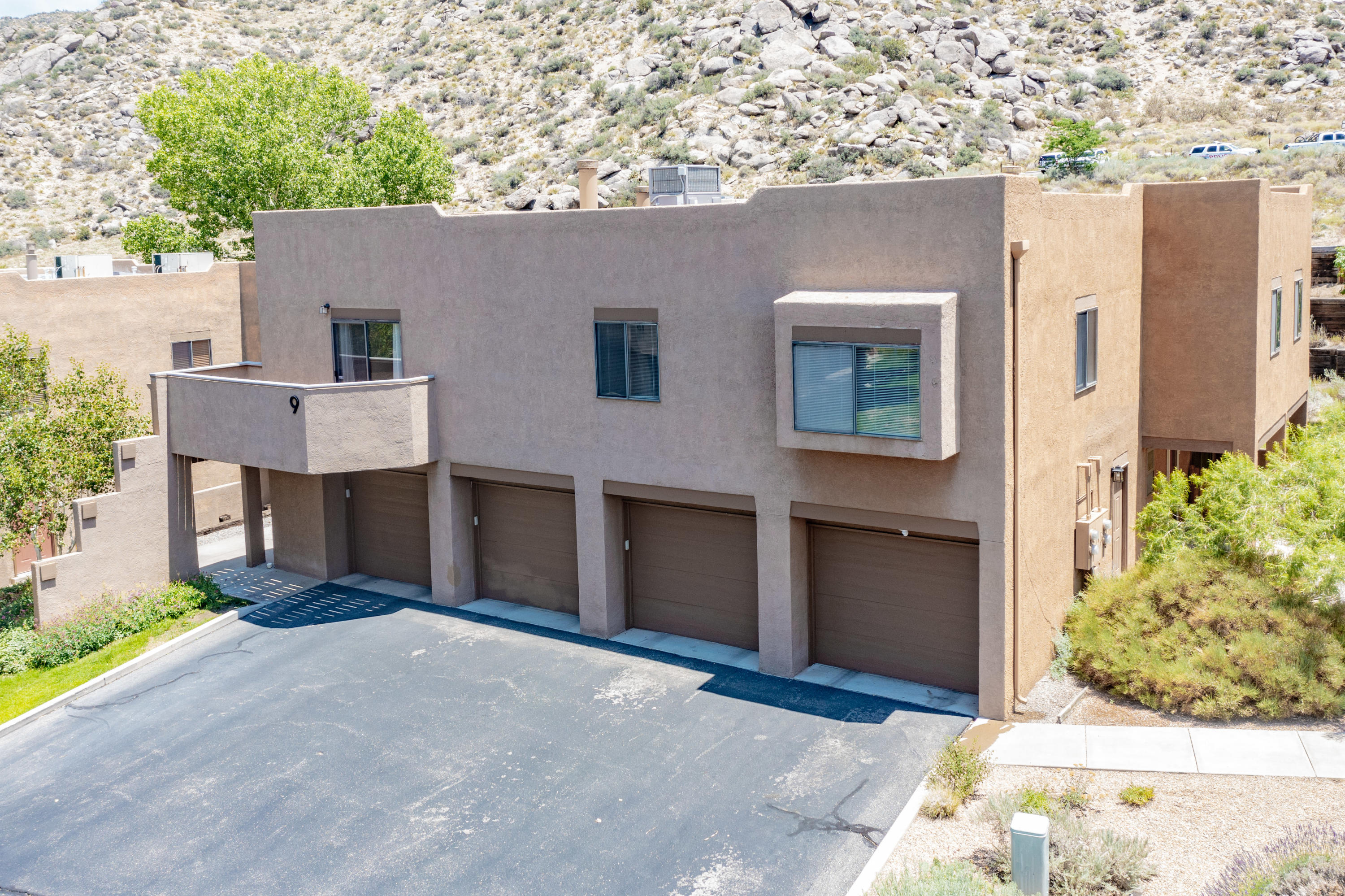 Situated at the base of the Sandia Mountains this 2 bedroom/2 full bathroom condo offers a functional floor plan, refrigerated air, and quick access to some mountain trails. Open kitchen and living room concept lend itself to easy entertaining, and the balcony beckons its new owner to take in the stunning NM sunsets and views. Attached one car garage not only provides shelter but it also boasts under staircase storage. This desirable location imparts a low maintenance lifestyle as the HOA takes care of the exterior of the residence, landscaping, and water. Schedule your viewing today!