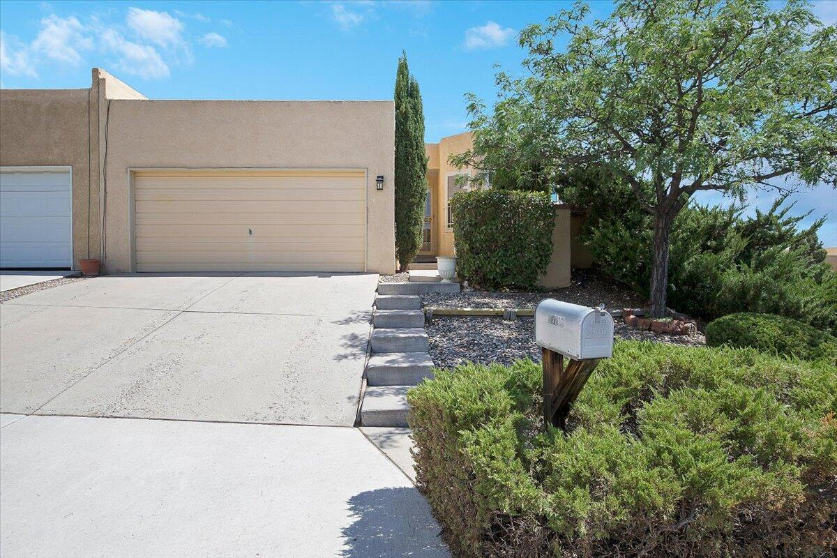 This spacious, well-cared-for home at the base of the Sandias is located on a corner lot and offers an easy commute to Sandia Labs and KAFB. The thoughtful design offers quiet and private living. The cozy eat-in kitchen allow a north glimpse of the Sandias from the bay windows. The large living/dining area features new skylights and custom window treatments. Owner's suite is conveniently located on the main level. Downstairs, you will find a second living area, two additional bedrooms, a full bath, extra closet space and utility area. Rebuilt redwood deck (6 yrs new and well maintained) spans the length of the home, providing beautiful views. Nicely landscaped L-shaped, low maintenance backyard with automatic sprinklers and drip system.  See seller's list of updates in documents.