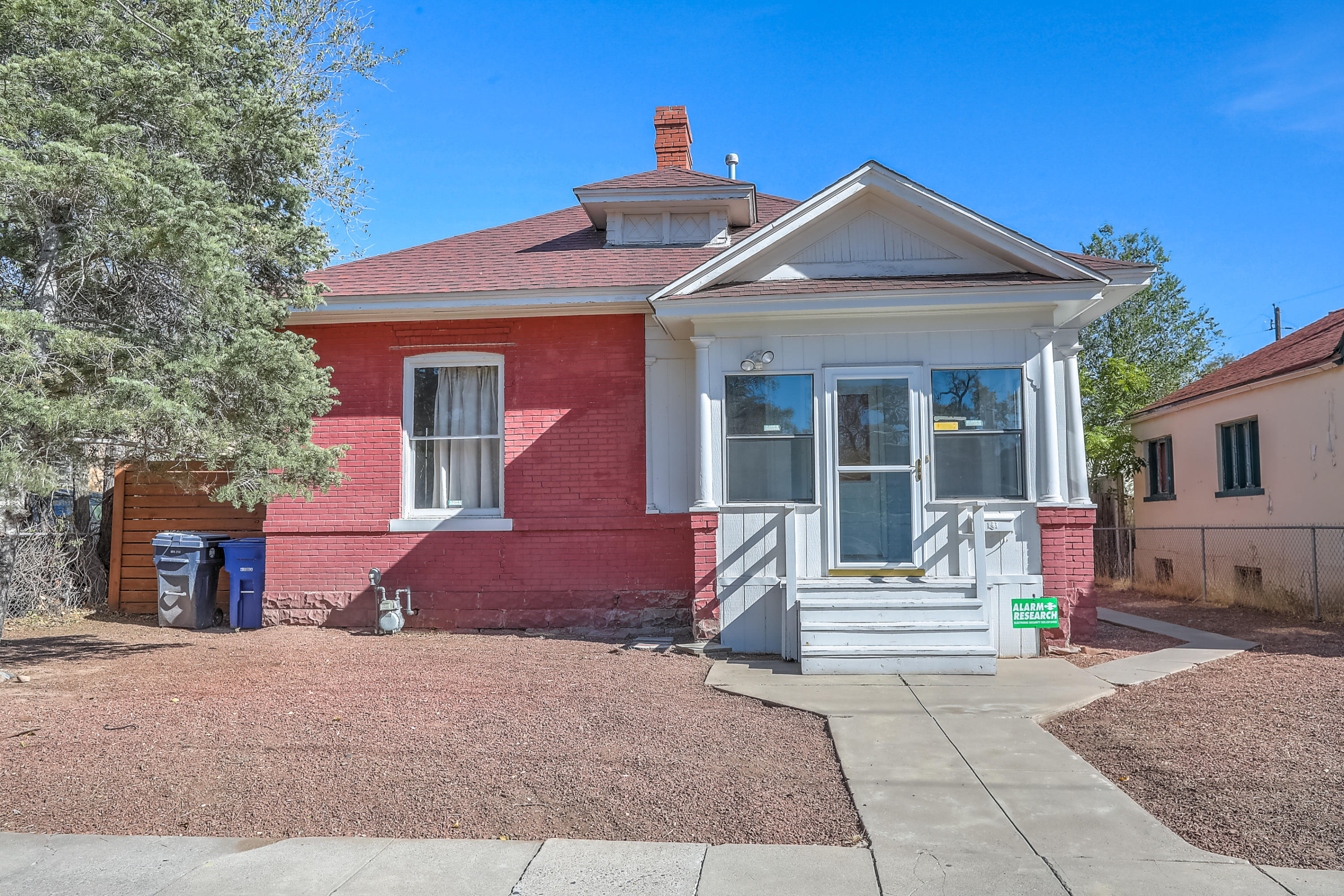Charming Victorian home in the heart of downtown Albuquerque with easy access to Old Town.  Enclosed front porch, wood floors, high ceilings, brick exterior, claw foot tub. A sunroom/office off of one of the bedrooms and a mudroom/laundry room at the back of the home that could have many uses. Refrigerated air and CFA heat. Newer backyard fencing with gate and plenty of backyard space for all your outdoor entertainment. Home is being sold ''as is.''