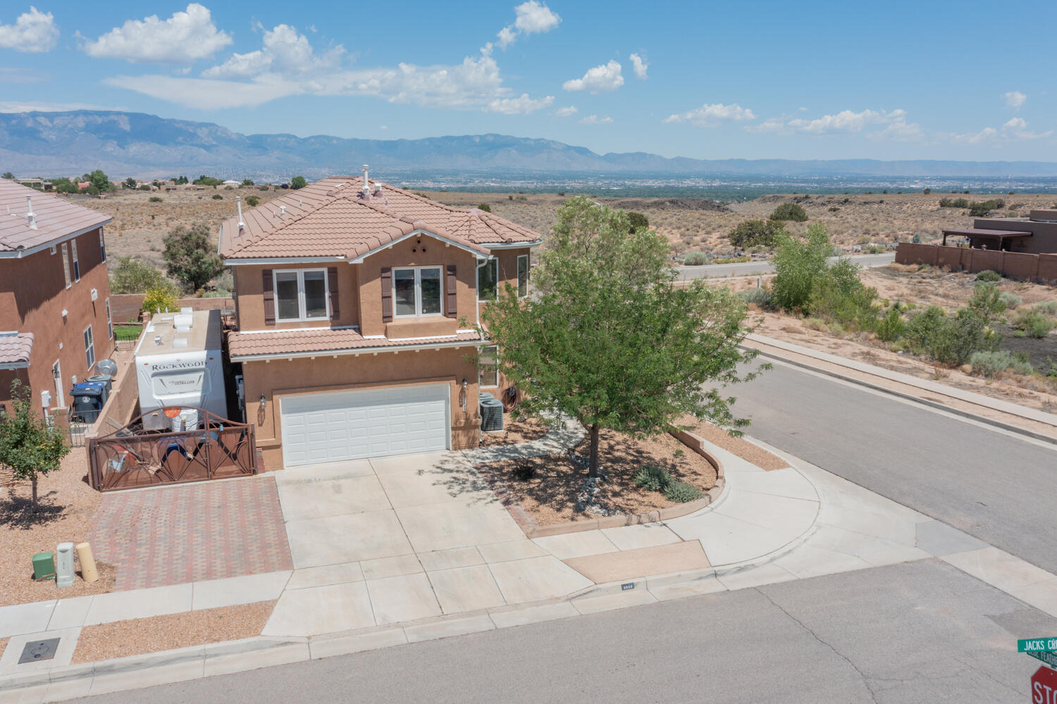 A rare find! This 5 bedroom with a loft, office space, formal dining room, large eat in kitchen has the space you are looking for with owned solar too!! Don't miss out on the views from the backyard with petroglyph national monument land directly behind the property (No future builds!!). The north side of the home has backyard access for your toys or camper! Inside of the home you will find an area that can be used as an office/playroom/etc, front living (large enough for a pool table), formal dining room, eat in kitchen and living room. Head upstairs to find FIVE bedrooms, a loft, and a large master bathroom with a beautiful master bathroom, walk in closet and private balcony. The property is 100% landscaped as well! This home is truly exceptional and waiting for its new owners