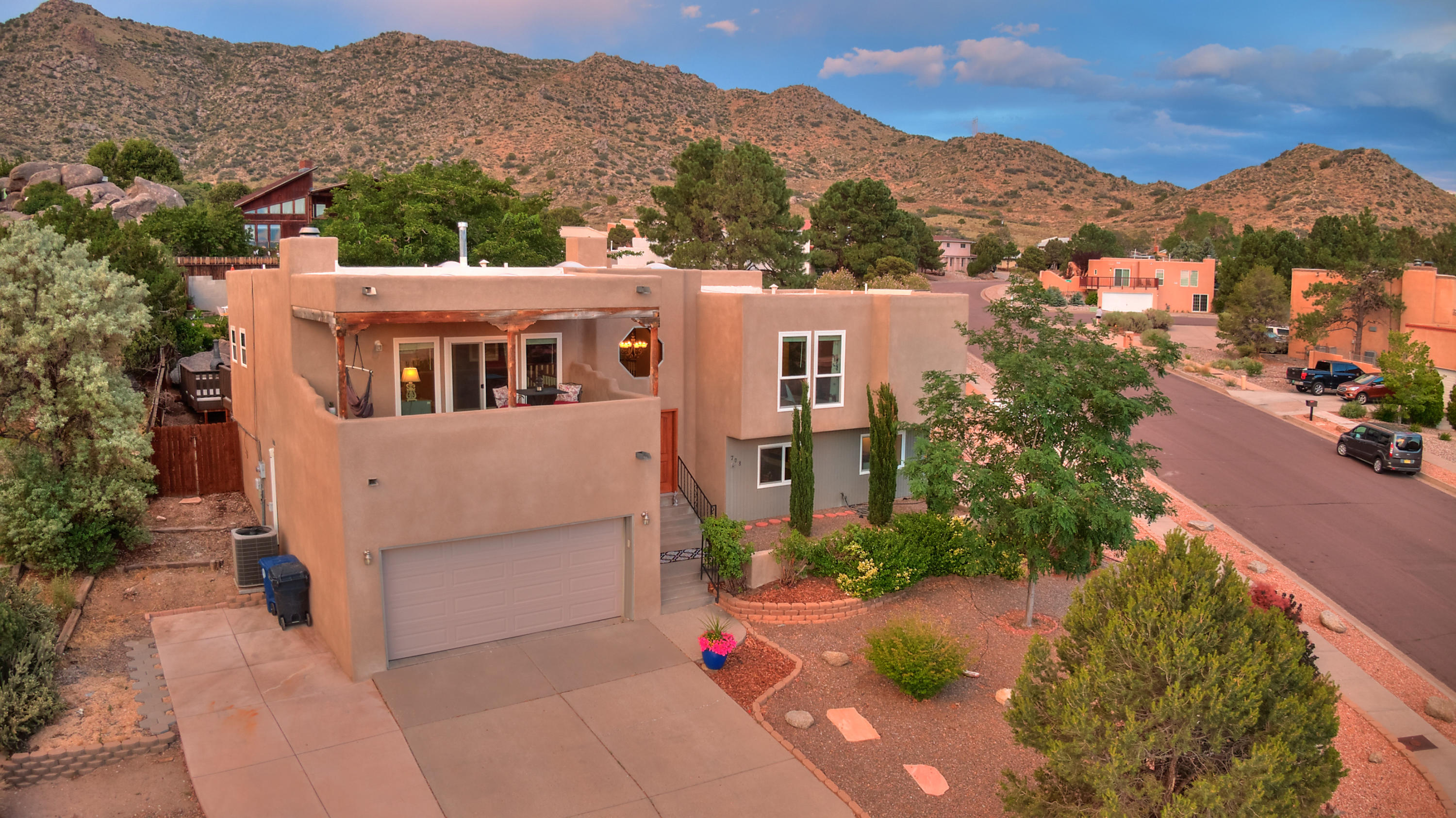 This gorgeous and meticulously maintained, East of Tramway, home has it ALL. Huge corner lot that backs up to open high desert landscape, private pool, completely updated interior, possible 5 bedrooms and amazing views from all angles. 2''x6'' construction through the ENTIRE home. The backyard is an entertainer's paradise. The 2017 stucco, 2016 GACOFlex roof, 2018 flooring, 2016 hot water heater, 2017 pool pump, among many other selling points, ensure that your new home will last for years to come needing minimal maintenance. The lawn furniture, fire pit, hot tub, wine fridge, refrigerator and dishwasher stay with the property so you can move right in! This home is an absolute gem in a spectacular neighborhood. Do not miss this one.