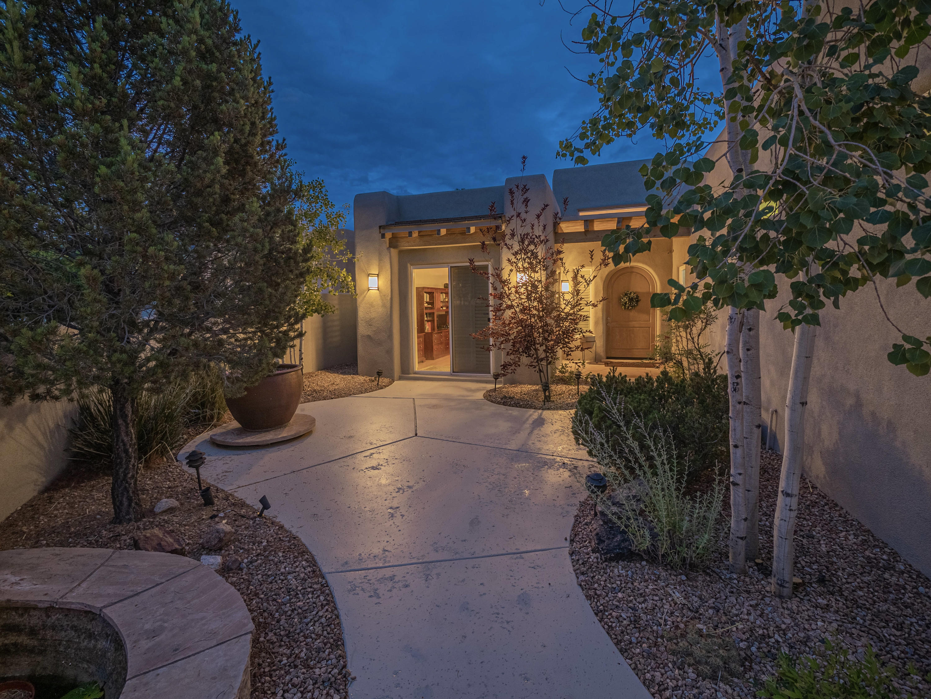 **Open House Sunday, 7/25 from 1pm-3pm***HIGH DESERT LIVING AT IT'S FINEST!! Open the gate to the private courtyard with soothing cascading water fountain and enter through the custom hand carved front door. Once you cross over the threshold the WOW FACTOR transcends throughout this impeccably kept home. The original owner wasthe builder himself (Starbright Custom Homes) and you can certainly tell with the extra attention to detail in every room. This 3-bedroom single level Contemporary Southwest style home offers incredible features to include a stacked stone waterfall upon entry, large great room with GORGEOUS MOUNTAINVIEWS and beeswax fireplace, absolutely amazing kitchen with cherry wood cabinets and floating drawers.