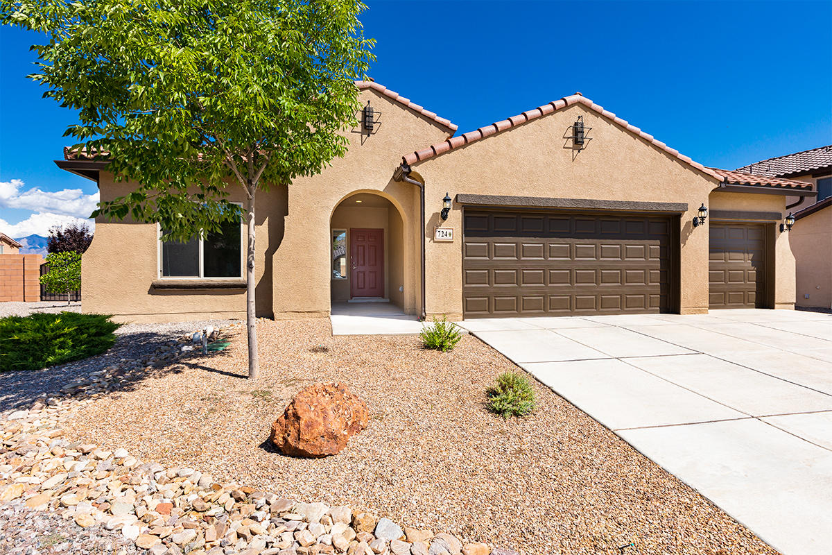 Stunning single level home located in the desirable community of Loma Colorado. Popular Pulte Pinnacle Series with a Silver Premium corner lot on .24 acres. Fully landscaped with cobblestone patio, synthetic grass, accented southwest rock and surrounded by a privacy wall. Newer home built in 2015. Open concept floor plan with 9' ceilings. Stunning kitchen with a large island featuring granite countertops, glass tile backsplash and stainless steel appliances and great natural light. The owner's suite is spacious with a walk-in closet, soaking tub, and separate shower. Completely separate from the other bedrooms for maximum privacy. 4 bedrooms, 2 full baths and an oversized 3-car garage. A+ location minutes from Rio Rancho High School with miles of walking, biking trails and multiple parks.