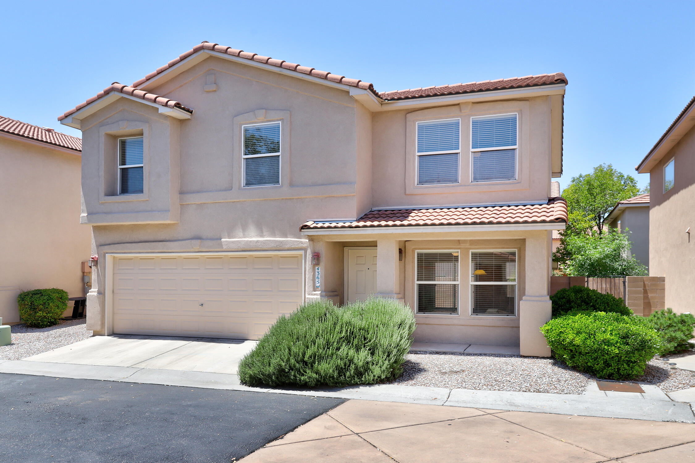 Great location in the desirable gated community of Altura Village. Close proximity to UNM, Nob Hill, Whole Foods, shopping, restaurants and easy freeway access. New hot water heater installed in December 2019.  The stucco was done by Dreamstyle , a nationally known but local firm in 2016 at a cost of $23K.  The stucco job included a solid ''brown coat'' base for the color coat.  The seller says there are no discernable cracks because of this process.  Two car garage, refrigerated air and the washer/dryer are included! Hard surface flooring on stairs and in hallway. Maintenance free (magnet driven) water softener.  The front yard is maintained by the HOA with a low maintenance backyard. Private park within the community. Come see this Altura Village gem today!