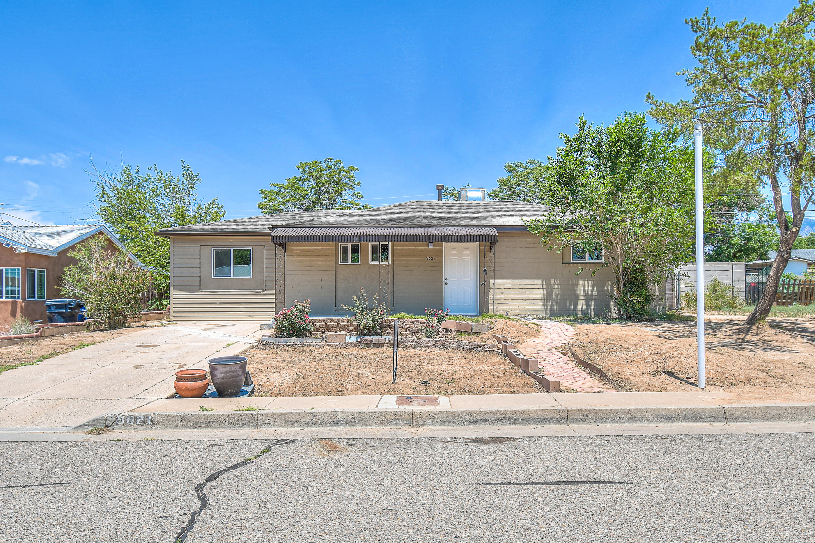 Updated throughout!  This NE Gem is move in ready and has been tastefully updated.  No stone was left unturned with new roof, new swamp cooler, brand new flooring, fresh paint and so much more!!   The kitchen has beautiful cabinets with brand new stainless appliances.  Bathroom has beautiful custom tile backsplash and new vanity.  Living room has a built in wooden book case and opens up into the lovely kitchen.