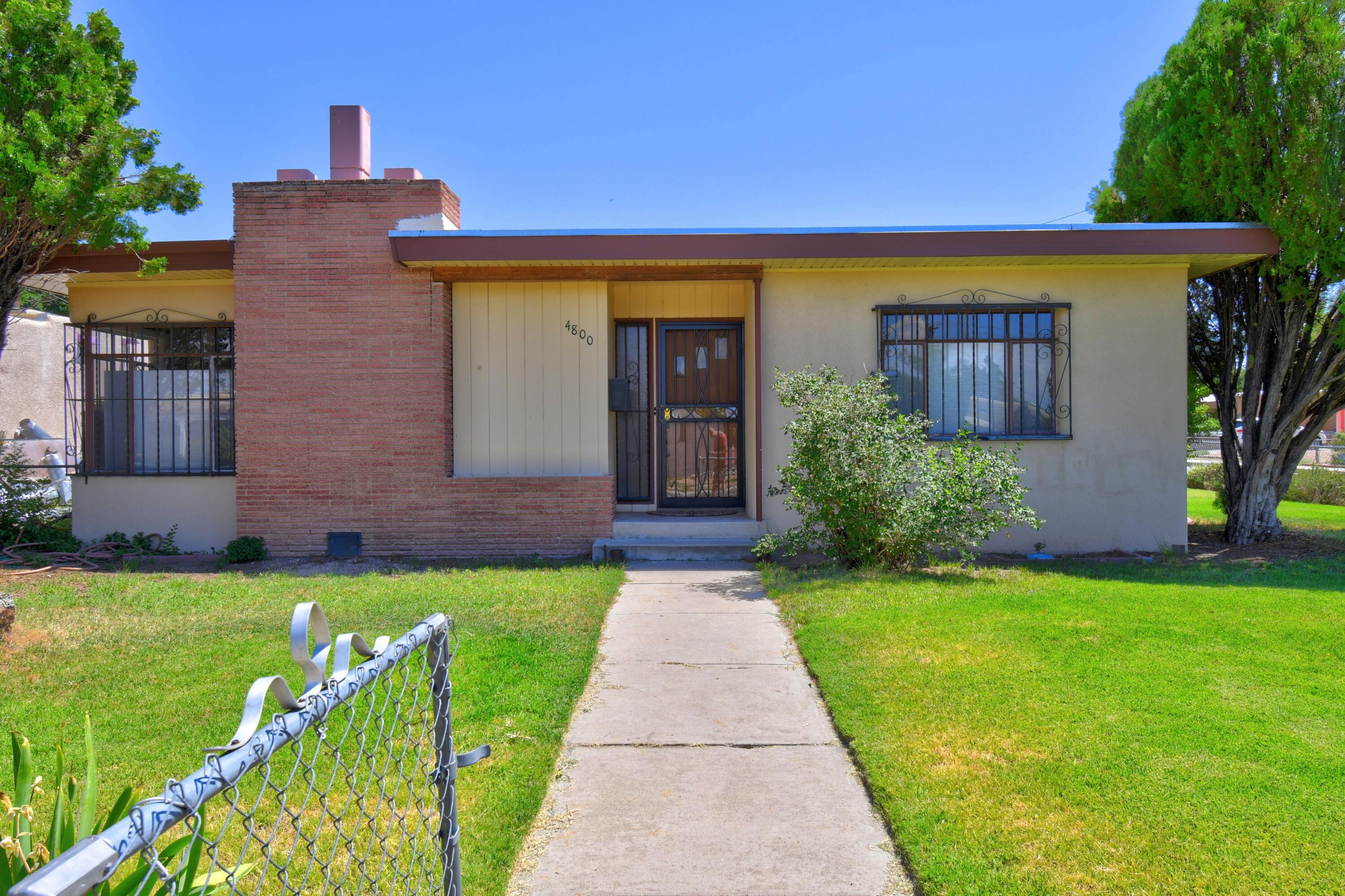 Come see this great home. Three bedroom 1.75 Bath with an attached 2 car garage. This well maintained home features refrigerated air, large living room with a wood stove, wood floors and cove ceilings.  Nicely landscaped front yard The back yard has covered patio and a large area with possible access which has many possibilities for entertaining.  Close to UNM, Nob Hill and Sandia National Labs.