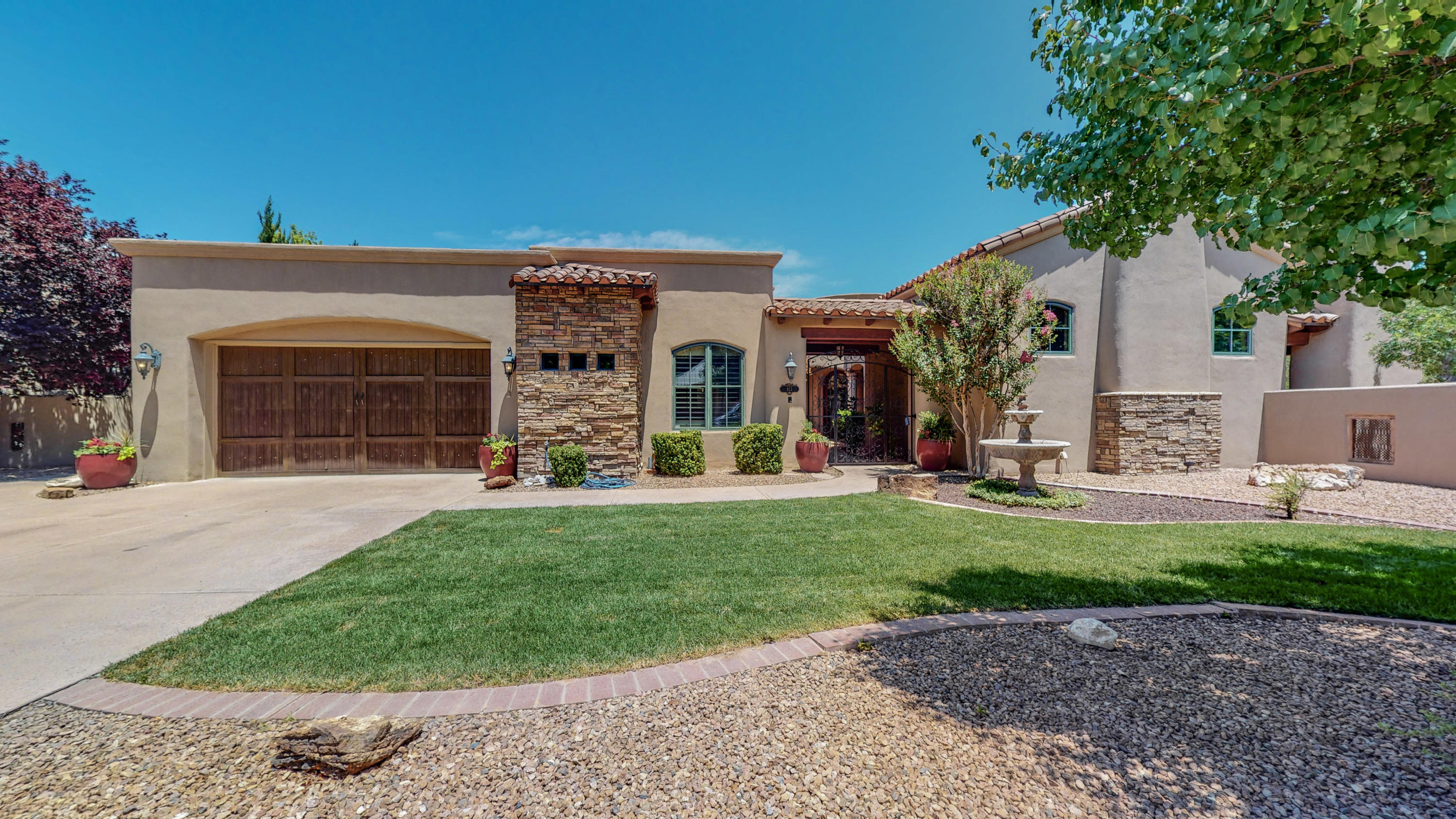 Looking for an elegant North Valley home with easy care landscaping? Come see this one level 3309 sf Tuscan home with 3 BR plus  large office, 3.5 baths, 2 indoor  fireplaces, beamed vaulted ceilings, surround sound & Venetian plaster walls. Hardwood & tile floors. Owner's suite has exercise room/extra office / nursery , large closet, huge shower, fireplace and direct access to 2 patios. Another ensuite bedroom could be a second master.  Bedroom 3 also has its own bath . Office has built-in bookshelves.  Spacious kitchen with Thermador 5 burner cooktop, pantry and large granite island  opens to adjacent dining and living rooms. Beautiful wrought iron gated entry , 2 additional courtyards with fireplaces & mountain views & grill or wind protected location.  Wonderful indoor/outdoor flow!