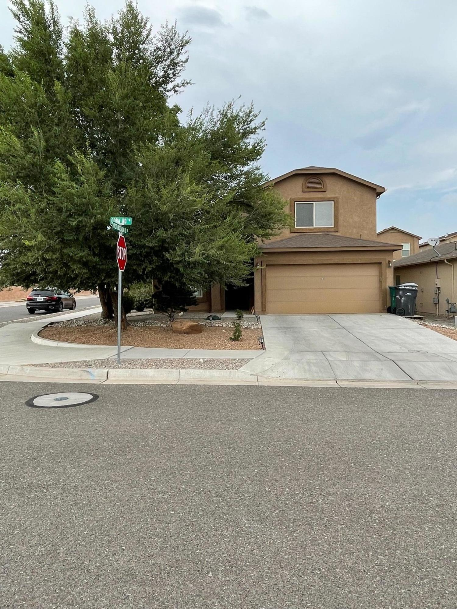 Ready for you to move in, Corner lot-Updates+Upgrades  Maple cabinets w/crown molding, granite counter top in kitchen and bathrooms, laminate flooring, tiles in wet area. Master bedroom in main floor -custom made  staircase and rails.