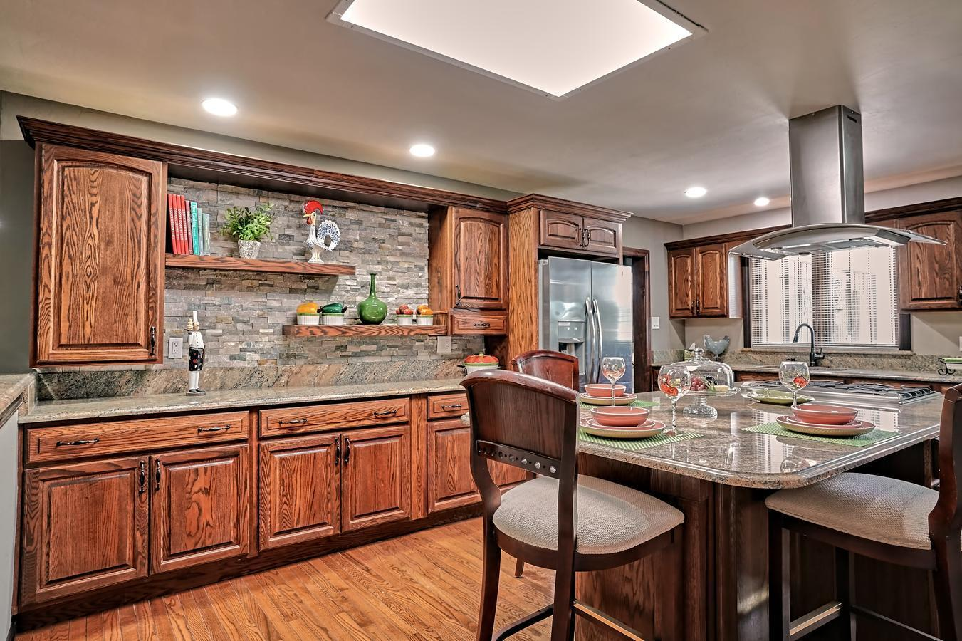 Hard to believe anyone would let this fabulous home go. Now you have a chance at it! GORGEOUS LEADED GLASS FRONT DOOR  and side lights welcome you to this absolutely lovely home in a quiet neighborhood close to services and shopping. Convenient to country club amenities at UNM Golf Club & Tennis or Tennis Club of Albuquerque for family recreation. New roof w/ 10-year warranty, Pella windows, Anderson wooden exterior doors, 2 HVAC units, upgrades in 2012 and 2021, including electrical. Home offers 2 large living areas, fabulous kitchen with eat in bar island, fireplace, formal dining, 3 bedrooms, office, vineyard, planting areas, pond and covered patio. Come see what this wonderful home offers you -- YOU'RE HOME!