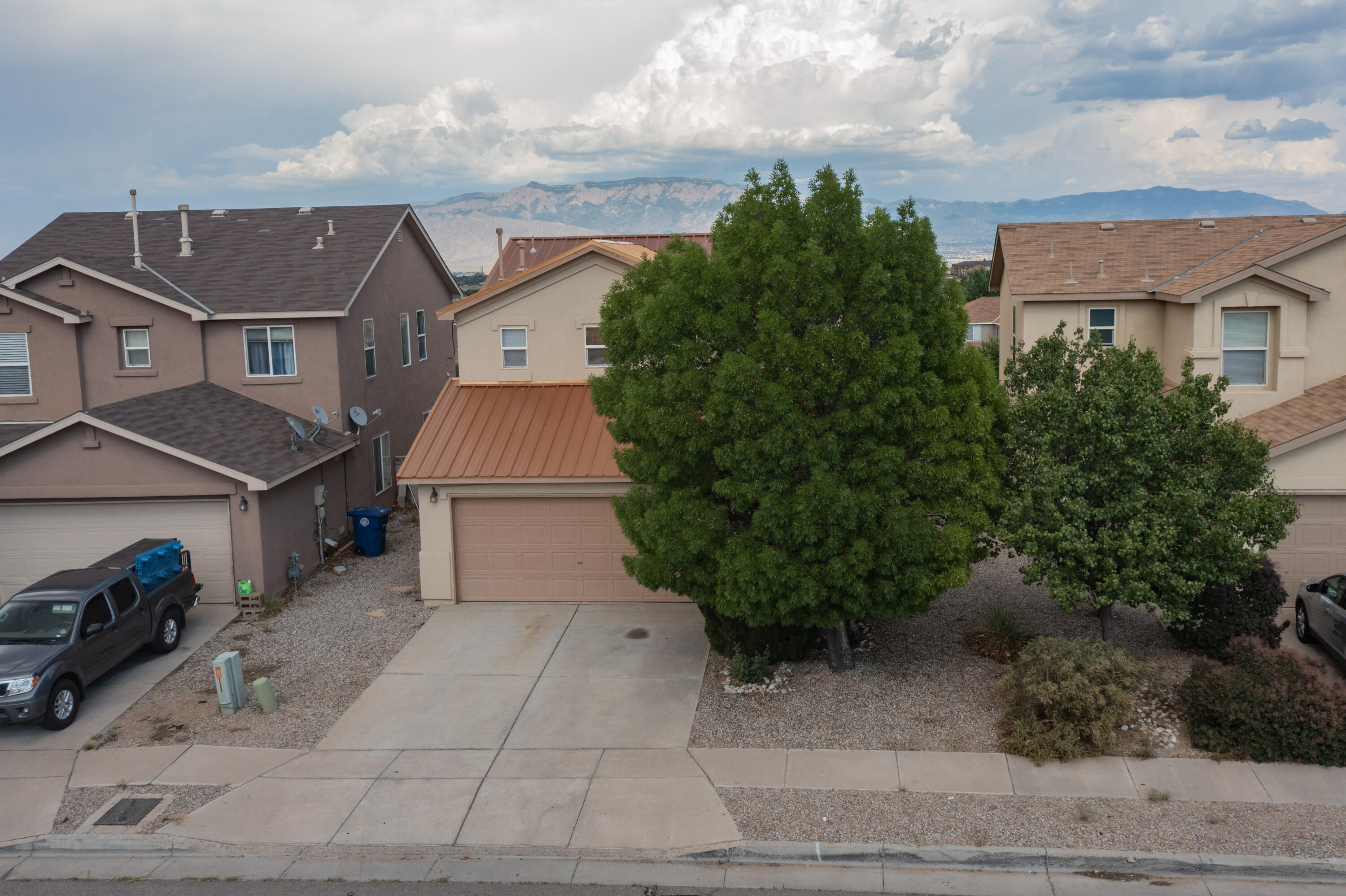 This is a wonderful opportunity to own a home on a premium lot with gorgeous mountain views. There is also No HOA, and No PID. 3 Bedrooms, 3 Bathrooms and Approximately 1639 Square Feet. Open and Bright Floor Plan, Gas Fireplace, Newer Copper Roof, Newer Water Heater, Large Master Bedroom, Downstairs Powder Bathroom, Additional Storage under stairs and ALL Appliances will convey. Large Backyard is partially landscaped with gravel and is a blank canvas for your imagination with Block walls and a Fenced Dog Run/Outdoor Storage Area. This home is ready for you to call home. There is also a beautiful park just right down the street with other larger parks nearby. Original Owner/Broker. Home Warranty will be supplied.