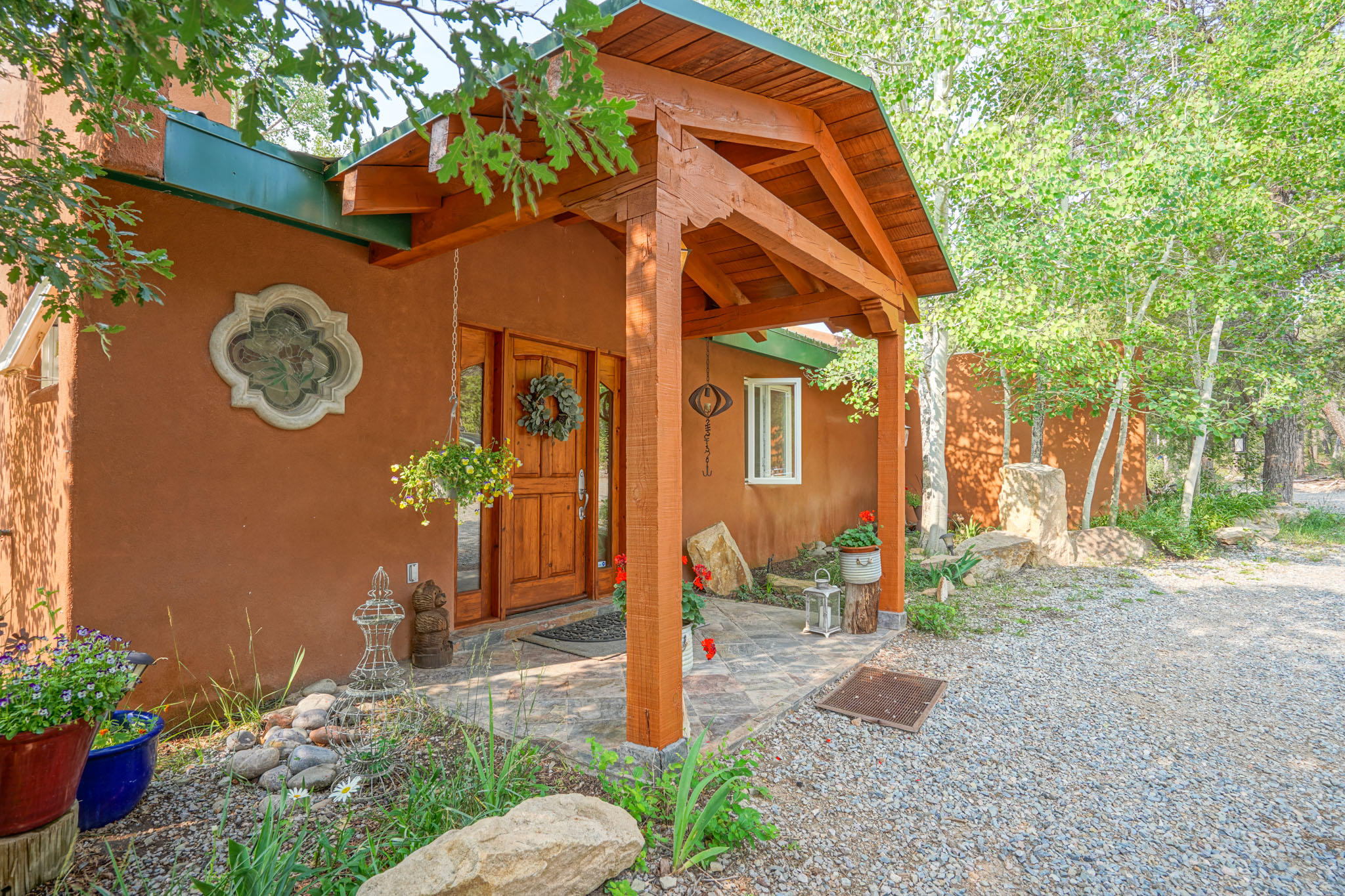 Tijeras' best kept secret! An exclusive 8 home community only 20 minutes from ABQ offers convenience and privacy. This property borders National Forest on 2 sides! This Architecturally-designed and Eco-Friendly home will captivate you the moment you walk through the door. The beautiful Vega ceilings and polished Saltillo tile give you the traditional New Mexico style you love, while the remodeled kitchen and smooth finished walls give you the modern look you need. Abundant amount of natural light. Passive solar, Low-E windows, and radiant heat keep utility costs low. Newer IB roof with transferable warranty! 220 outlet in garage. Gated entry for additional privacy. The VIEWS are breathtaking in all seasons. The engineered septic ''Wet Lands'' brings in wildlife all year. Horses permitted!