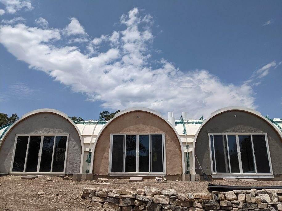 Fantastic opportunity for the handyman/ builder! Bring your tools & finish construction on this fabulous East Mountain off grid home! This home is situated ideally w/energy efficiency in mind! FRP construction system by greenmagichomes. The current owner has Completed approximately 75% of the construction! The majority of the solar system for electricity is in place! Water haul area , will need storage system or possibility to drill a well. Owner has been told there is a good well in the area. Nestled on 1.75 acres close to National Forest, Hiking & Biking! Fencing is not property line, land is large. Originally designed w/open plan LR/kitchen combo, media room, 2BR+2Bath.Owner has approximately 130K already invested, it is a bargain for the right buyer with vision & skill! Cash only